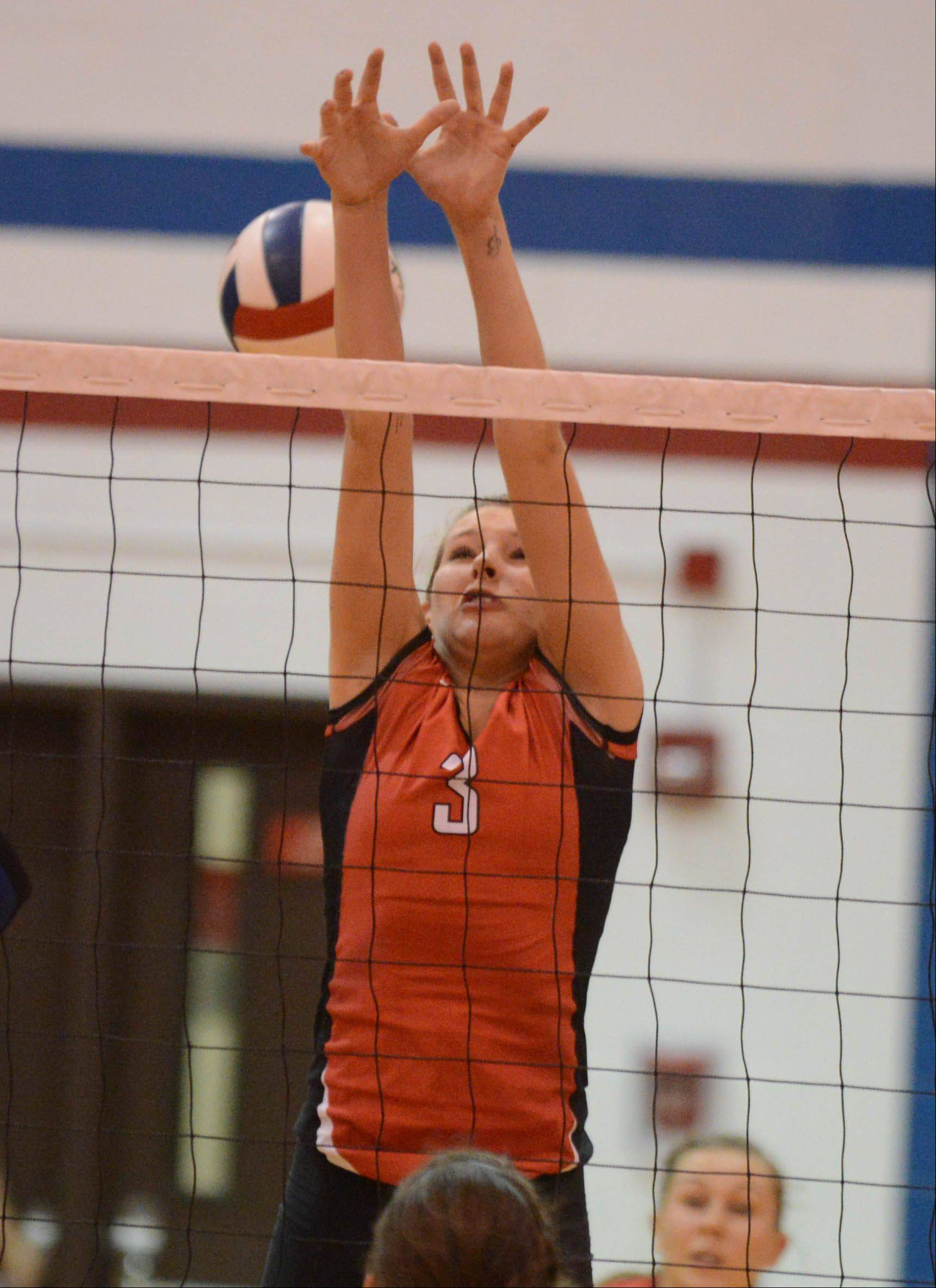 Hannah Loucks of Timothy Christian goes up for a ball at the Glenbard South girls volleyball match Tuesday.