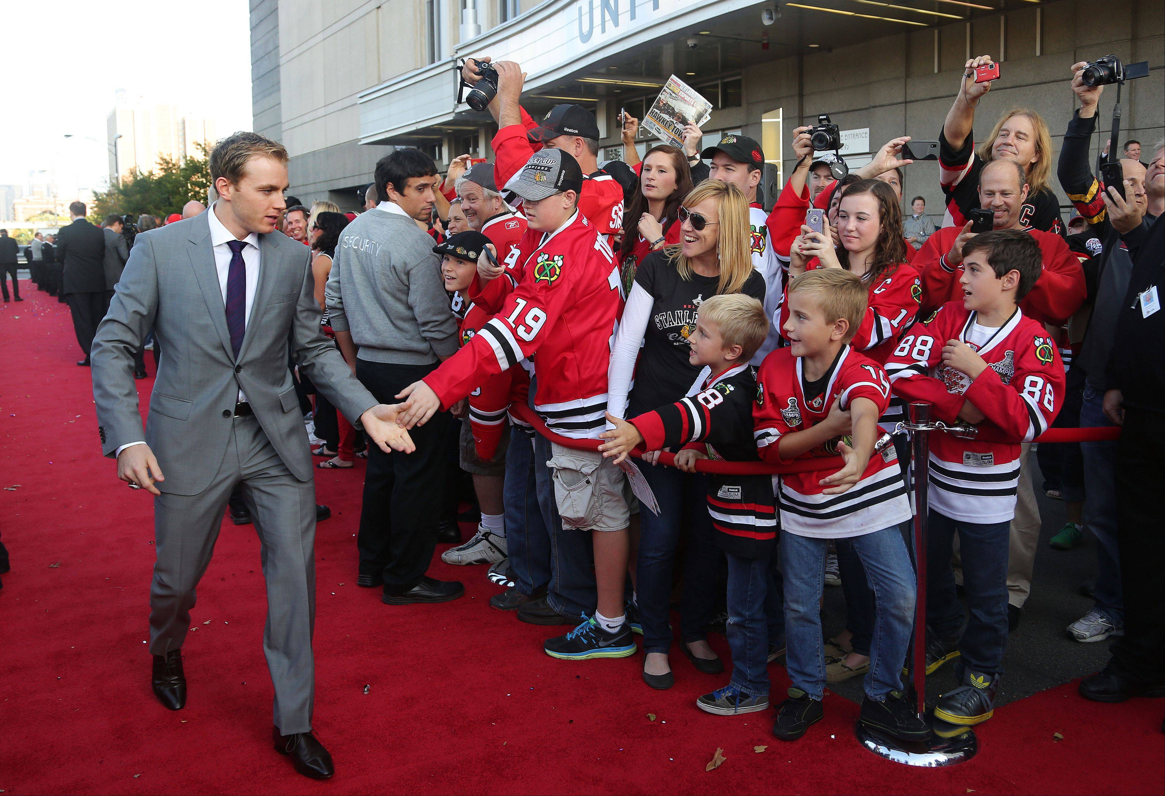 Chicago Blackhawks Patrick Kane high-fives fans.