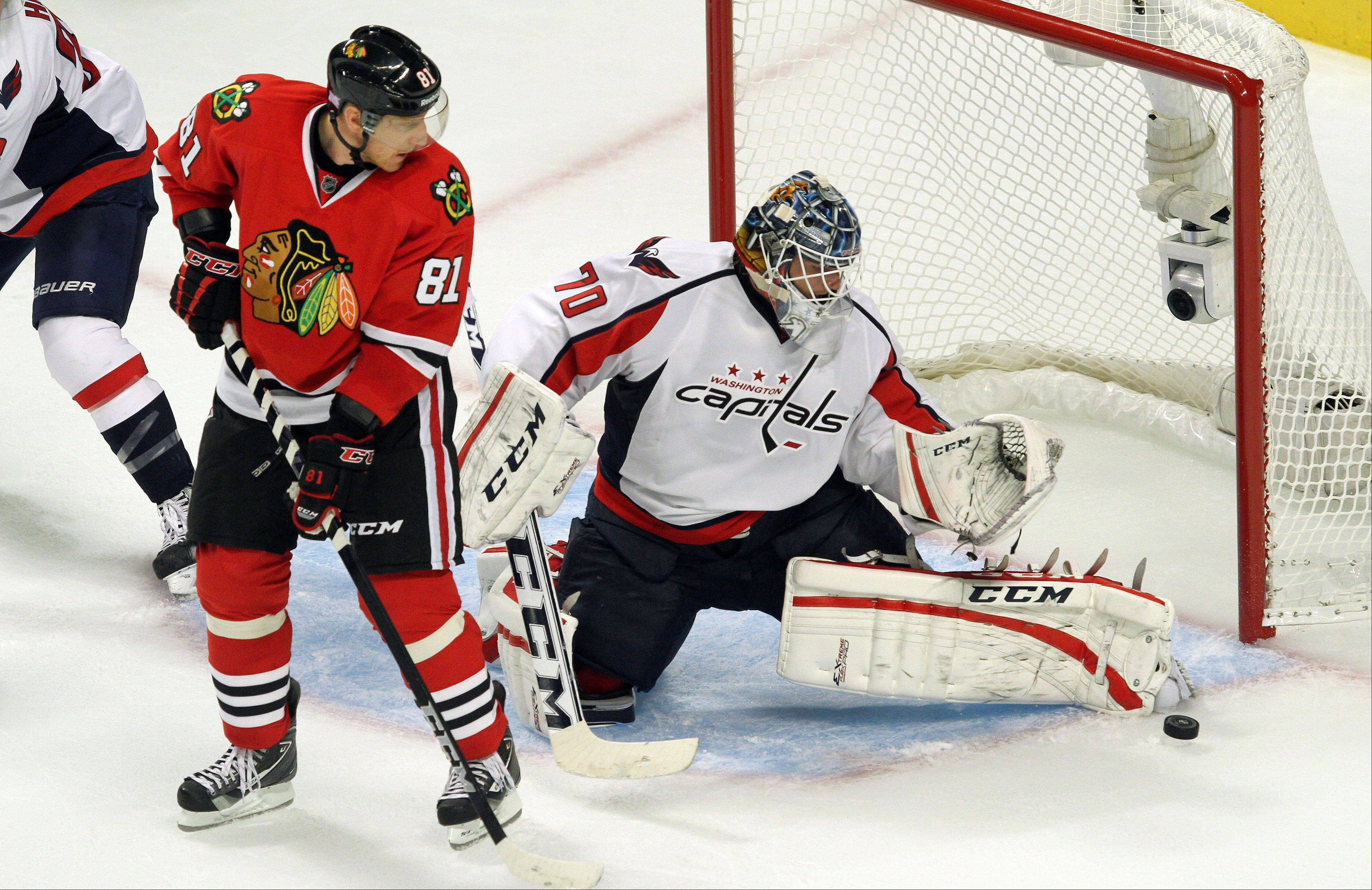 Chicago Blackhawks right wing Marian Hossa shoots on Washington Capitals goalie Braden Holtby.