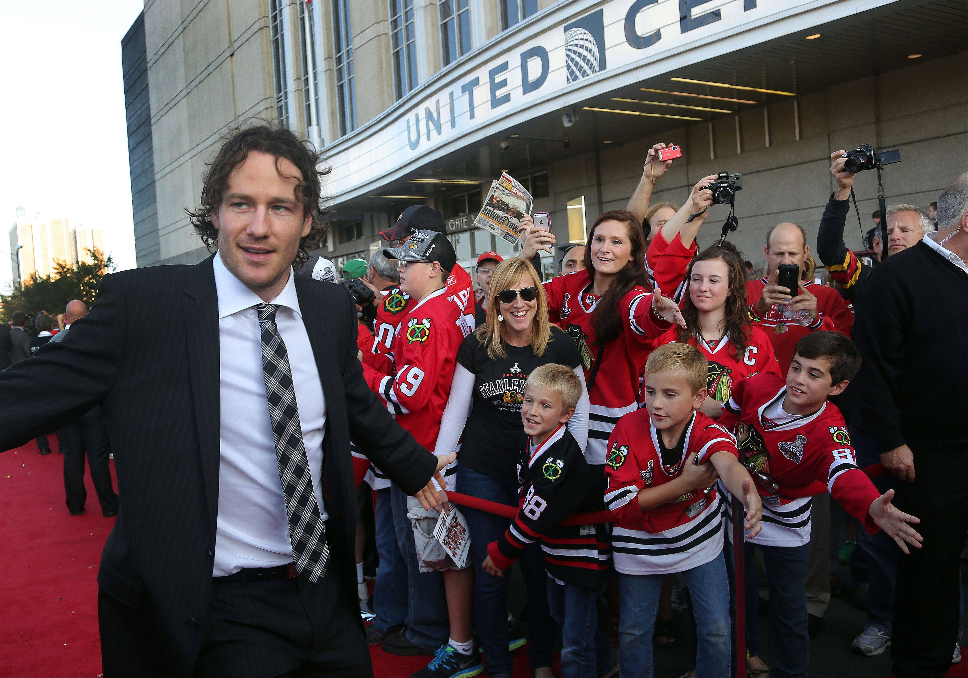 Chicago Blackhawks Duncan Keith high-fives fans.
