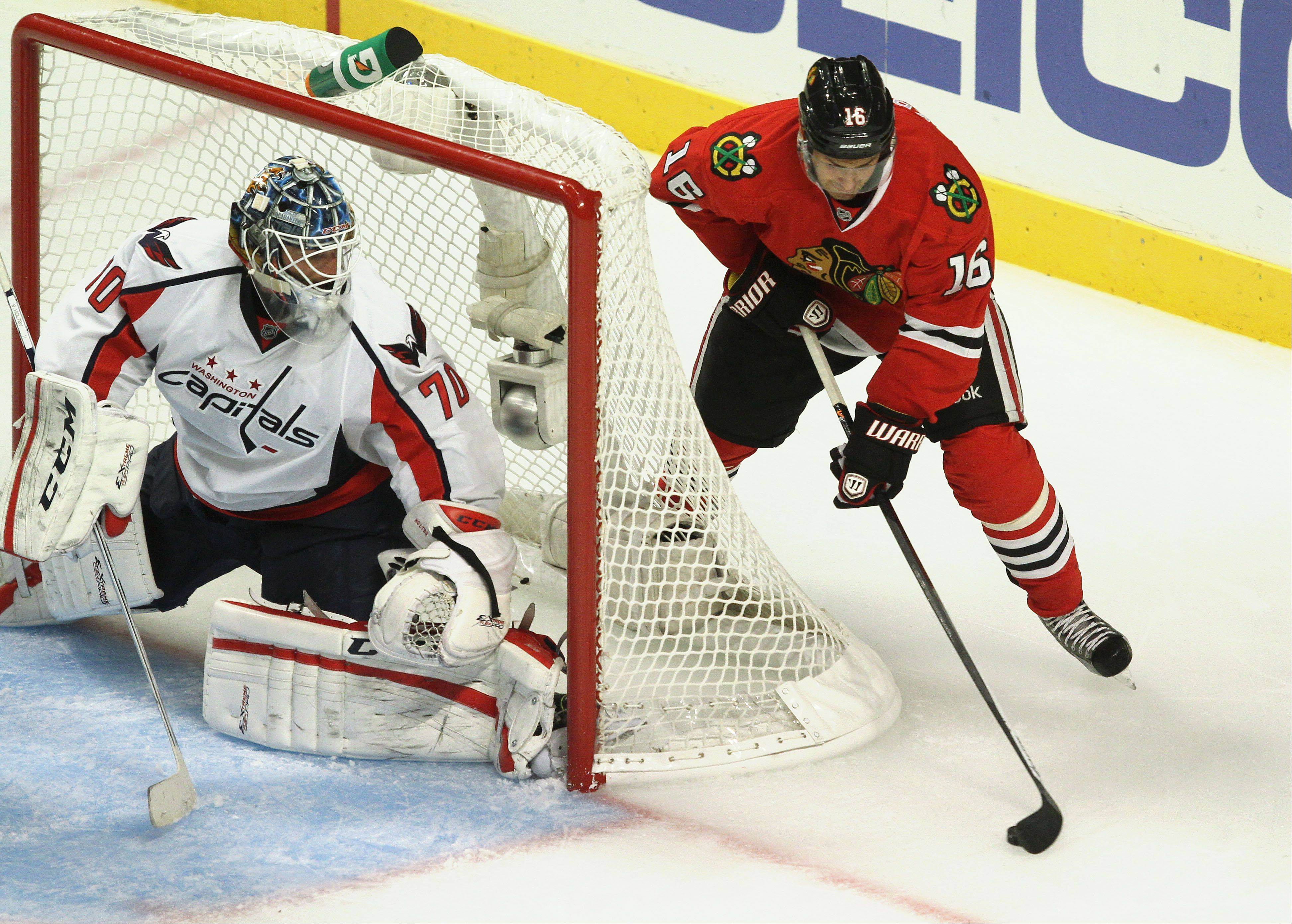 Chicago Blackhawks center Marcus Kruger tries a move on Washington Capitals goalie Braden Holtby.