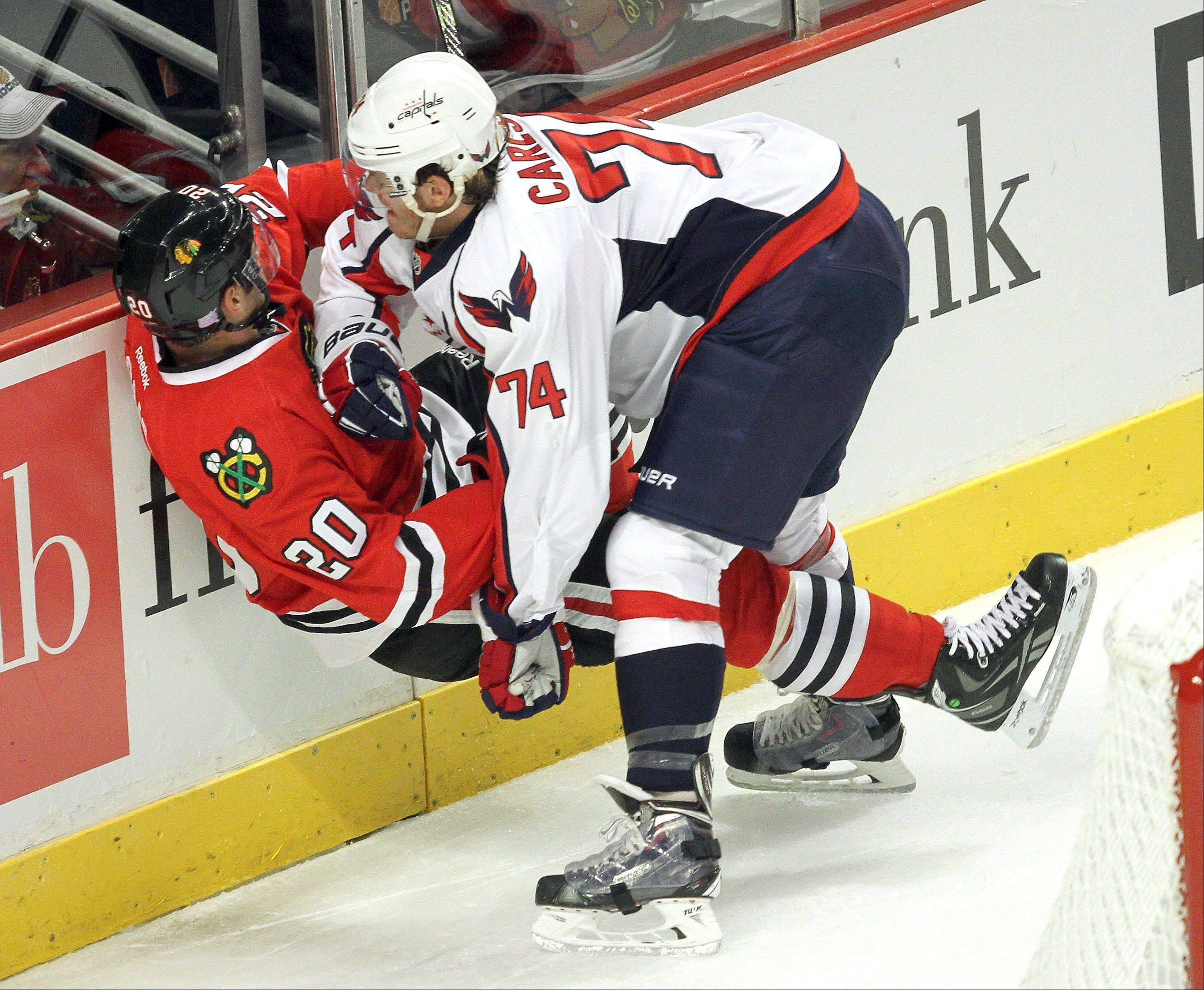 Chicago Blackhawks left wing Brandon Saad and Washington Capitals defenseman John Carlson collide.