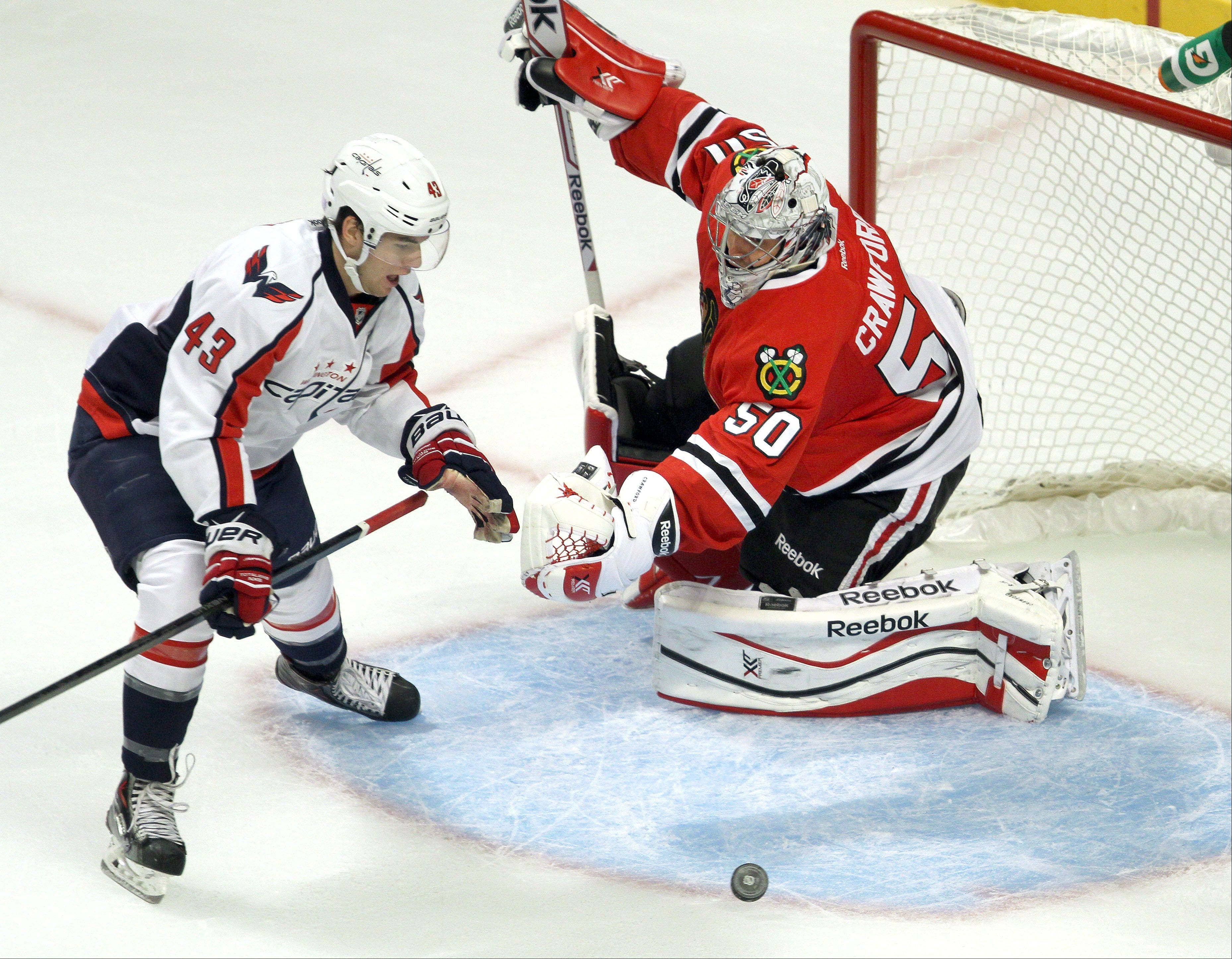 Chicago Blackhawks goalie Corey Crawford makes a save on Washington Capitals right wing Tom Wilson.
