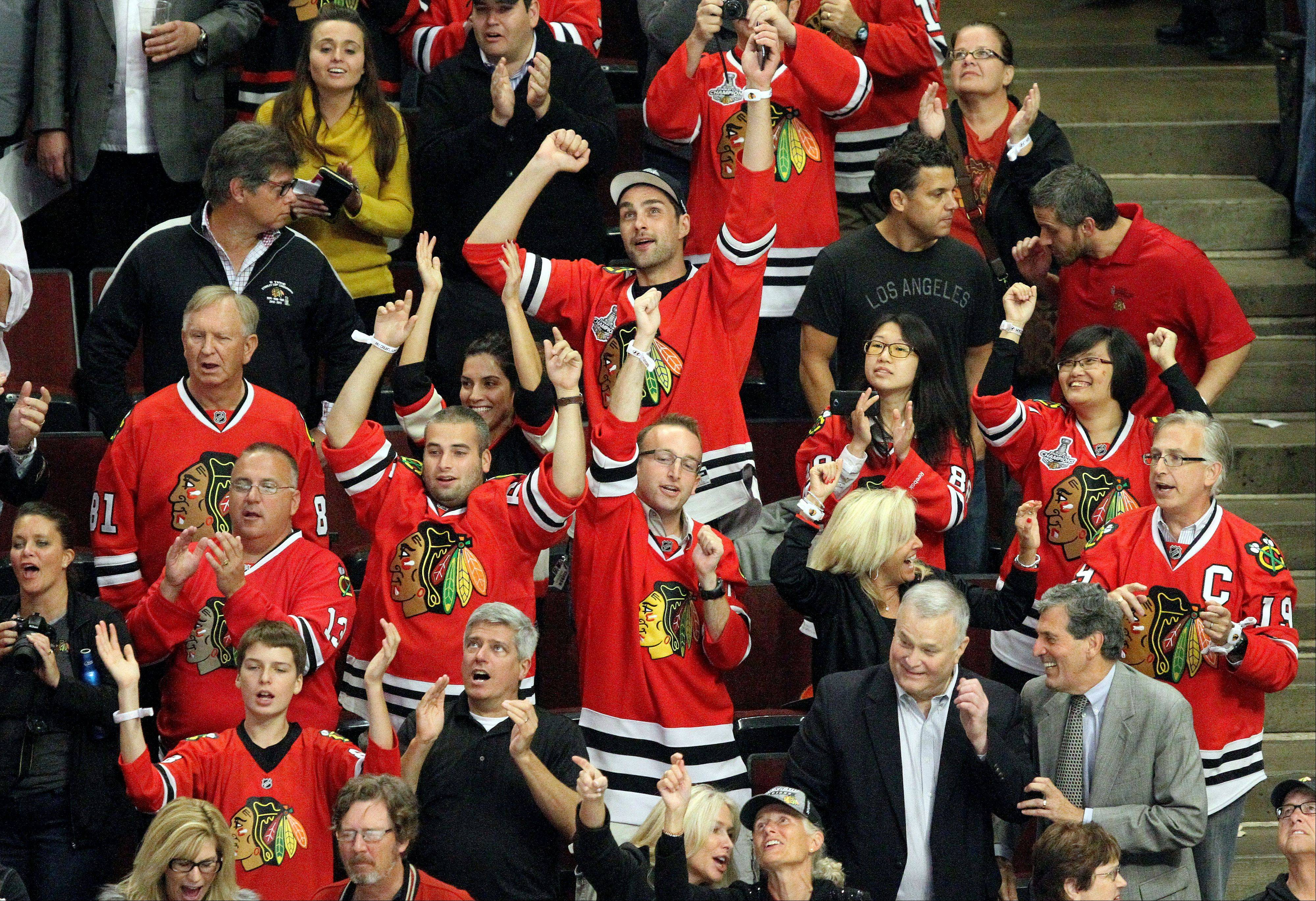 Fans cheer after the Blackhawks 6-4 win.