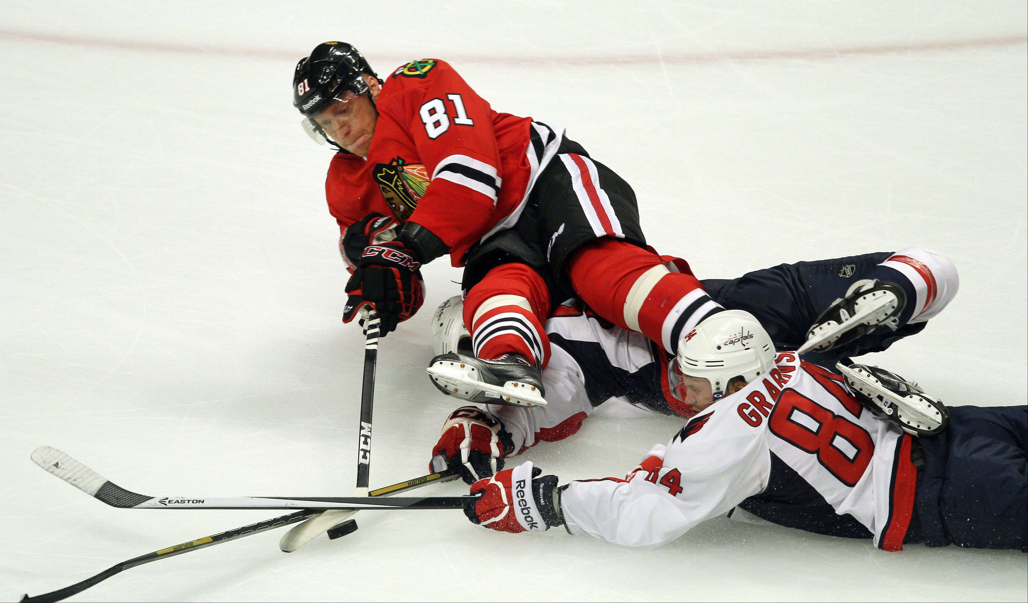 Chicago Blackhawks right wing Marian Hossa is taken down on an open net breakaway by Washington Capitals center Mikhail Grabovski .
