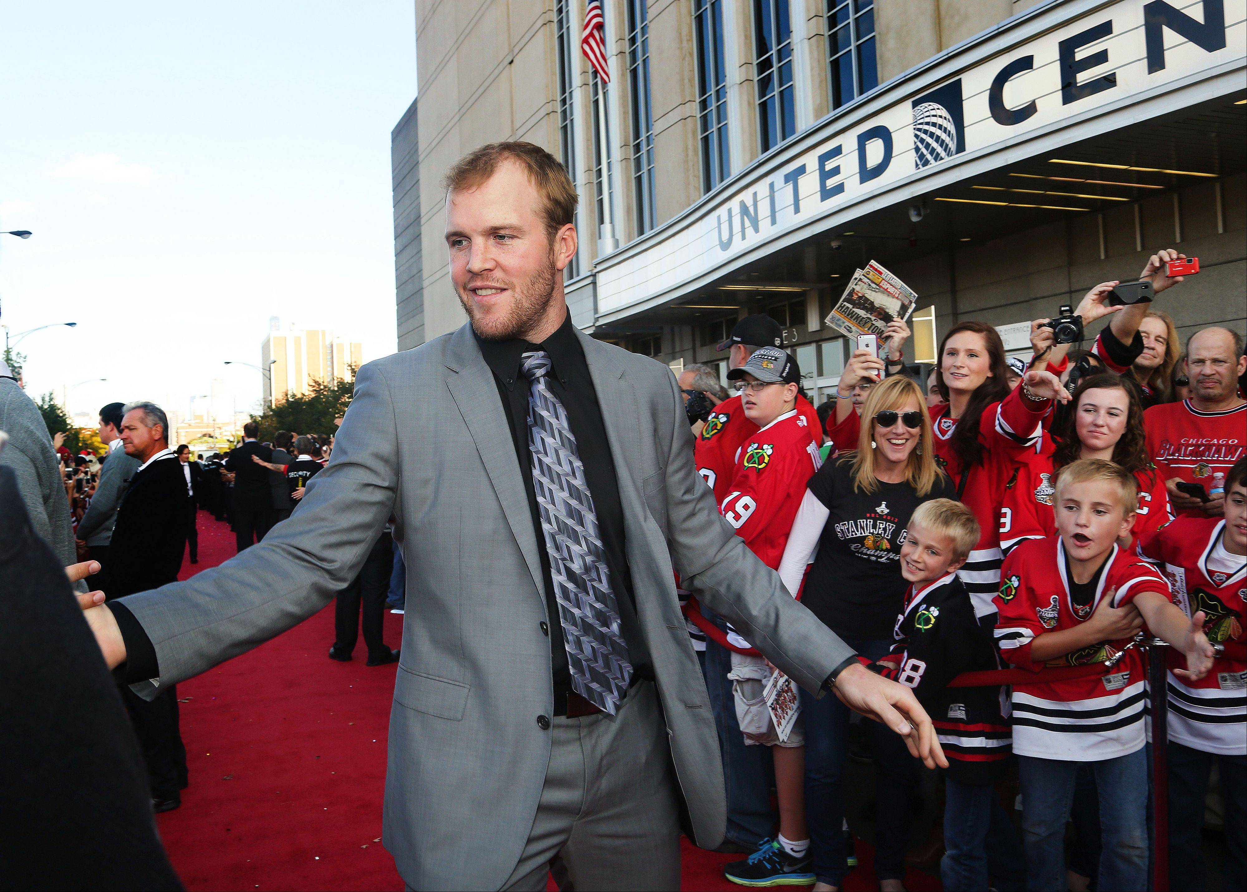 Chicago Blackhawks Bryan Bickell high-fives fans.