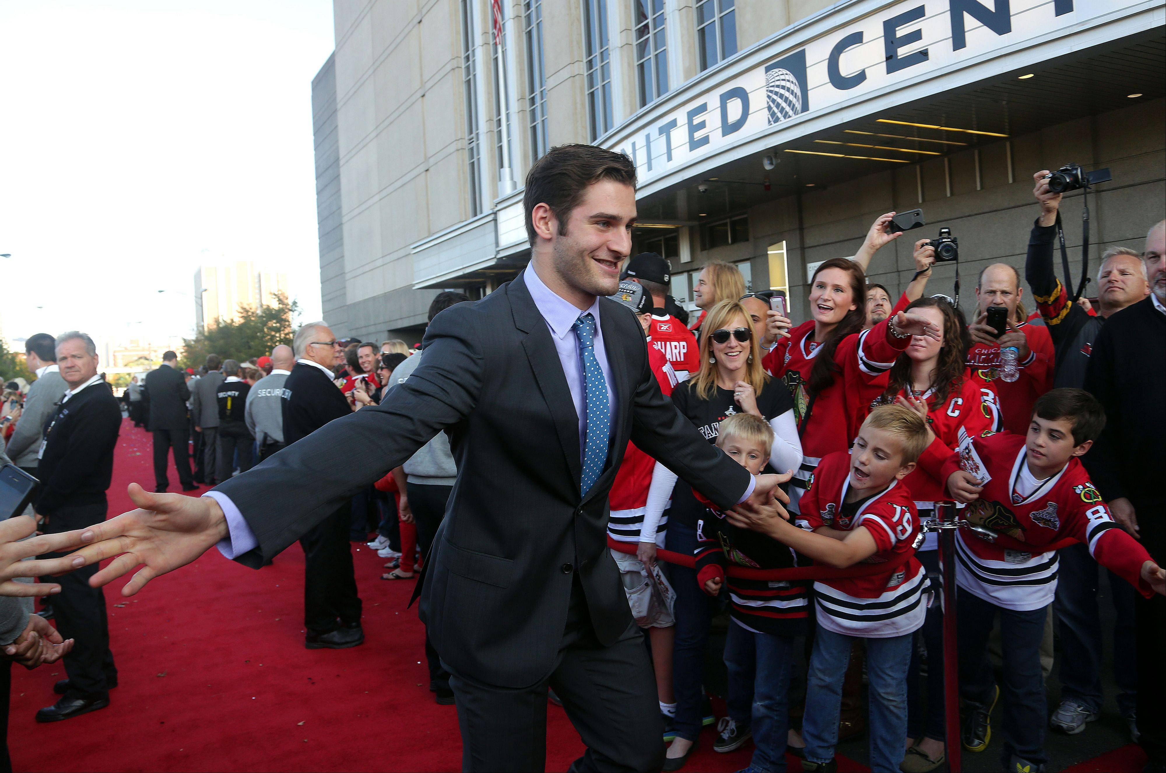 Chicago Blackhawks Brandon Saad high-fives fans.