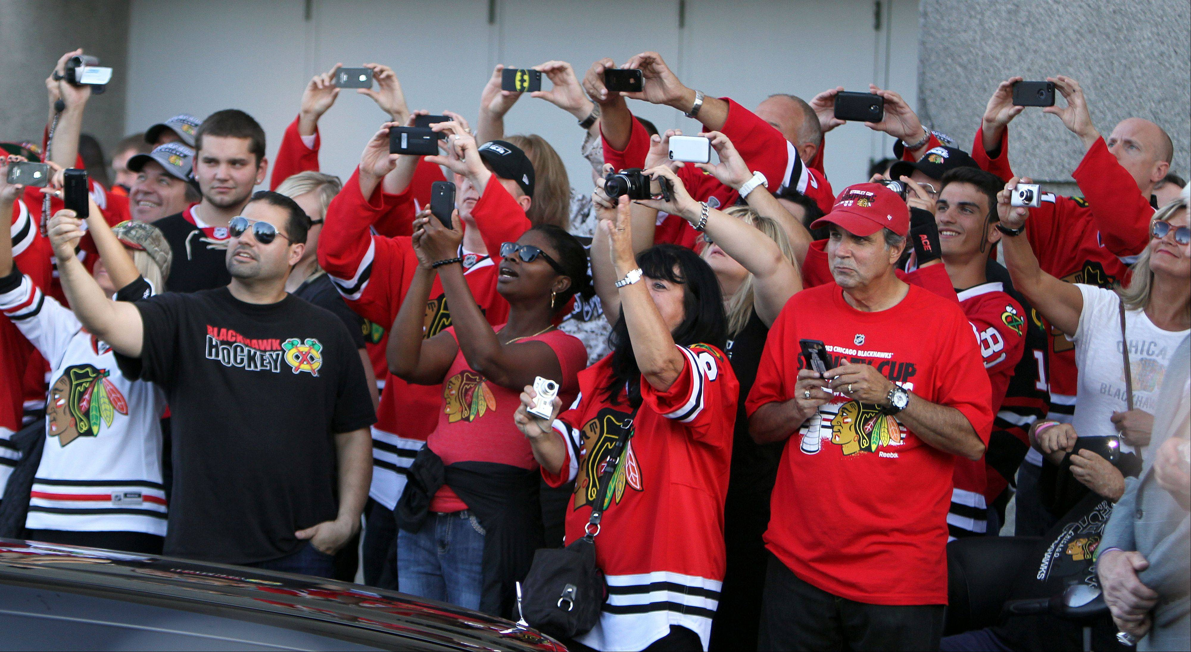 Fans cheer during a red carpet arrival of the Blackhawks.