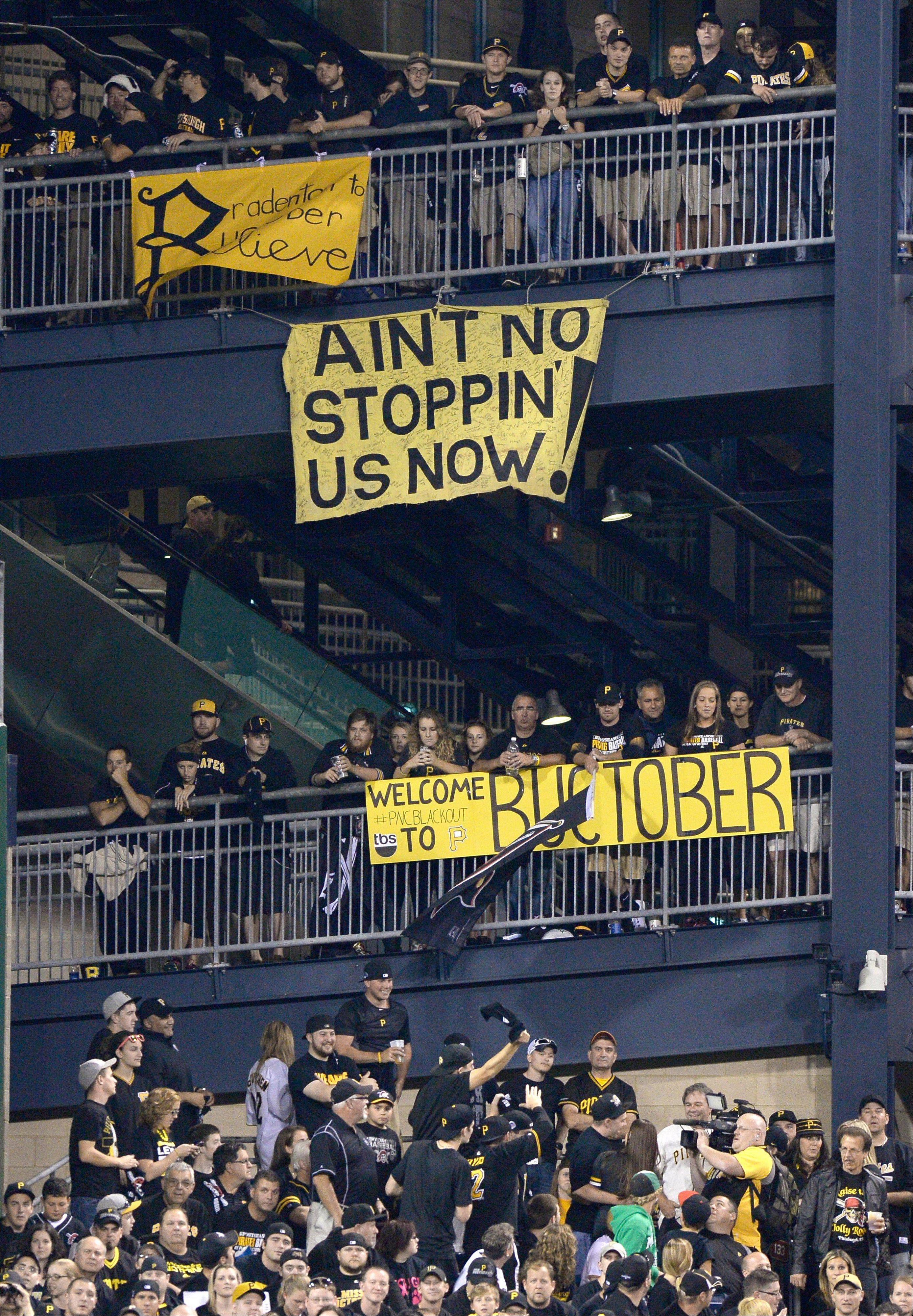 Banners supporting the Pittsburgh Pirates hang from the left field rotunda as the Pirates play the Cincinnati Reds in the NL wild-card playoff baseball game Tuesday, Oct. 1, 2013, in Pittsburgh.