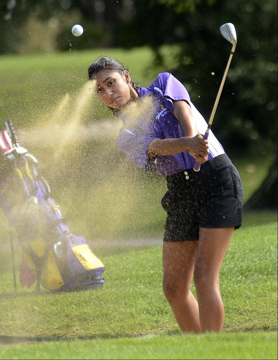Annette Yandall of Wauconda blasts out of the sand on 18 during the North Suburban Conference girls golf meet at Deerpath Golf Course in Lake Forest.