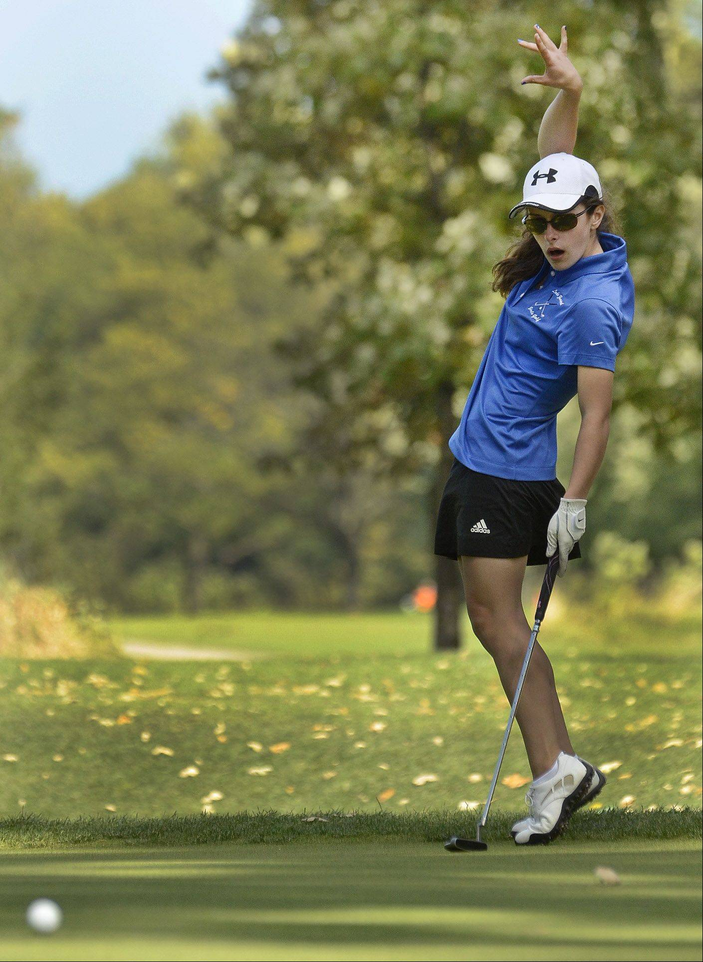 Megan Malcolm of Lake Zurich uses some body english on her putt on No. 15 during the North Suburban Conference girls golf meet at Deerpath Golf Course in Lake Forest.
