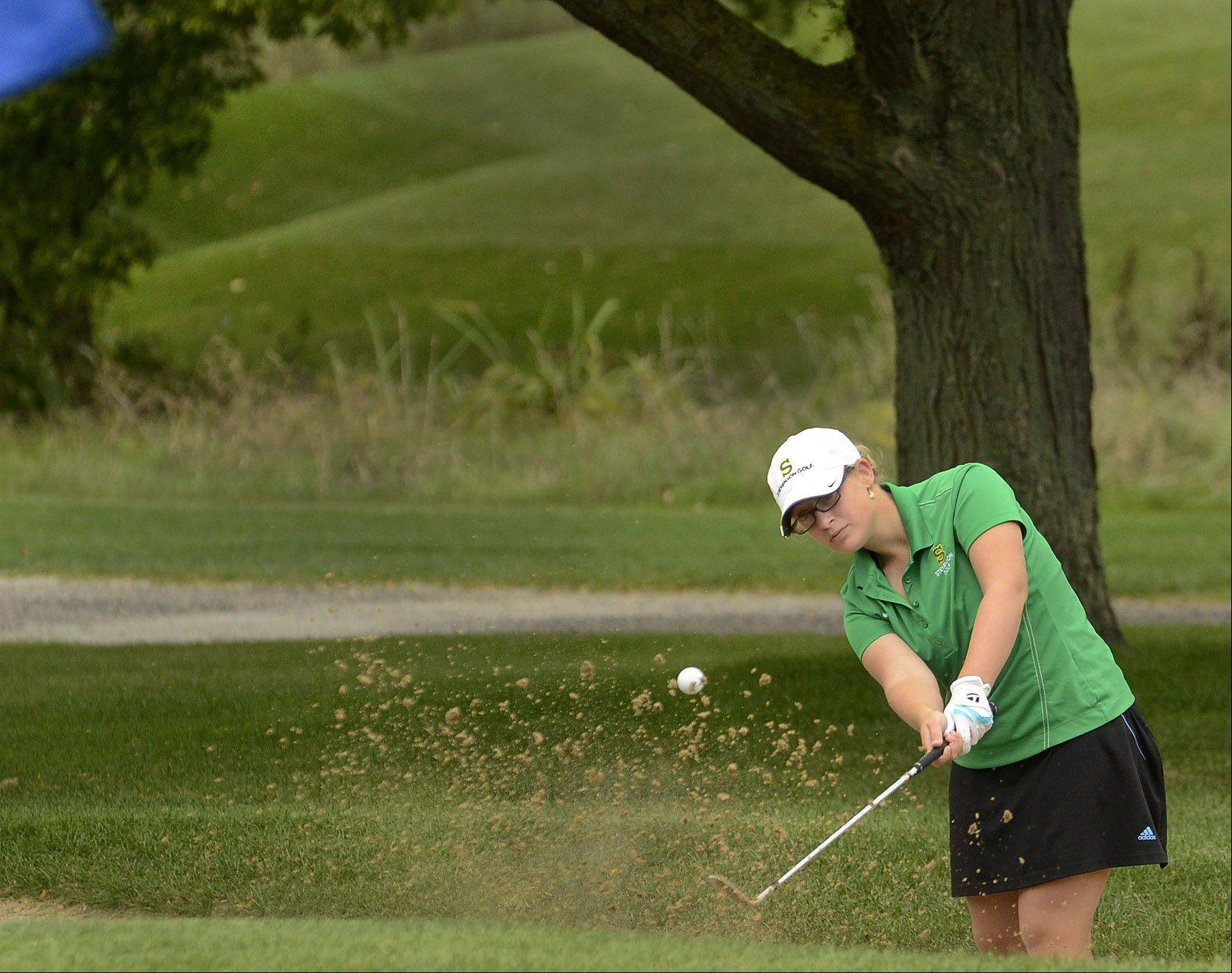 Bob Chwedyk/bchwedyk@dailyherald.comAlexia Fidman of Stevenson hits out of the sand by the ninth green during the North Suburban Conference girls golf meet at Deerpath Golf Course in Lake Forest.