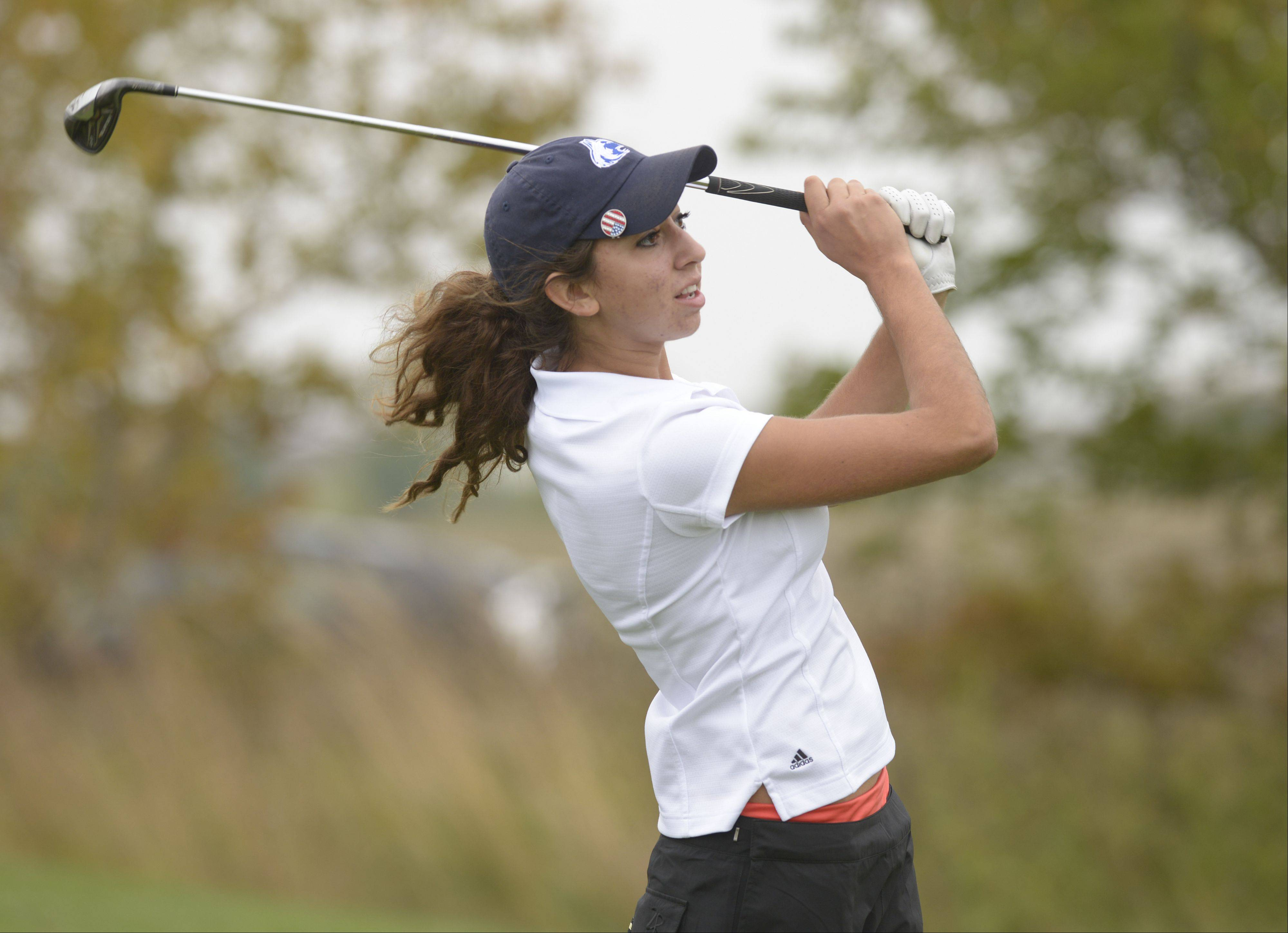 Taylor Arenson of Naperville North tees off on the 2nd hole during the DuPage Valley Conference girls golf at Phillips Park Golf course in Aurora, Tuesday.