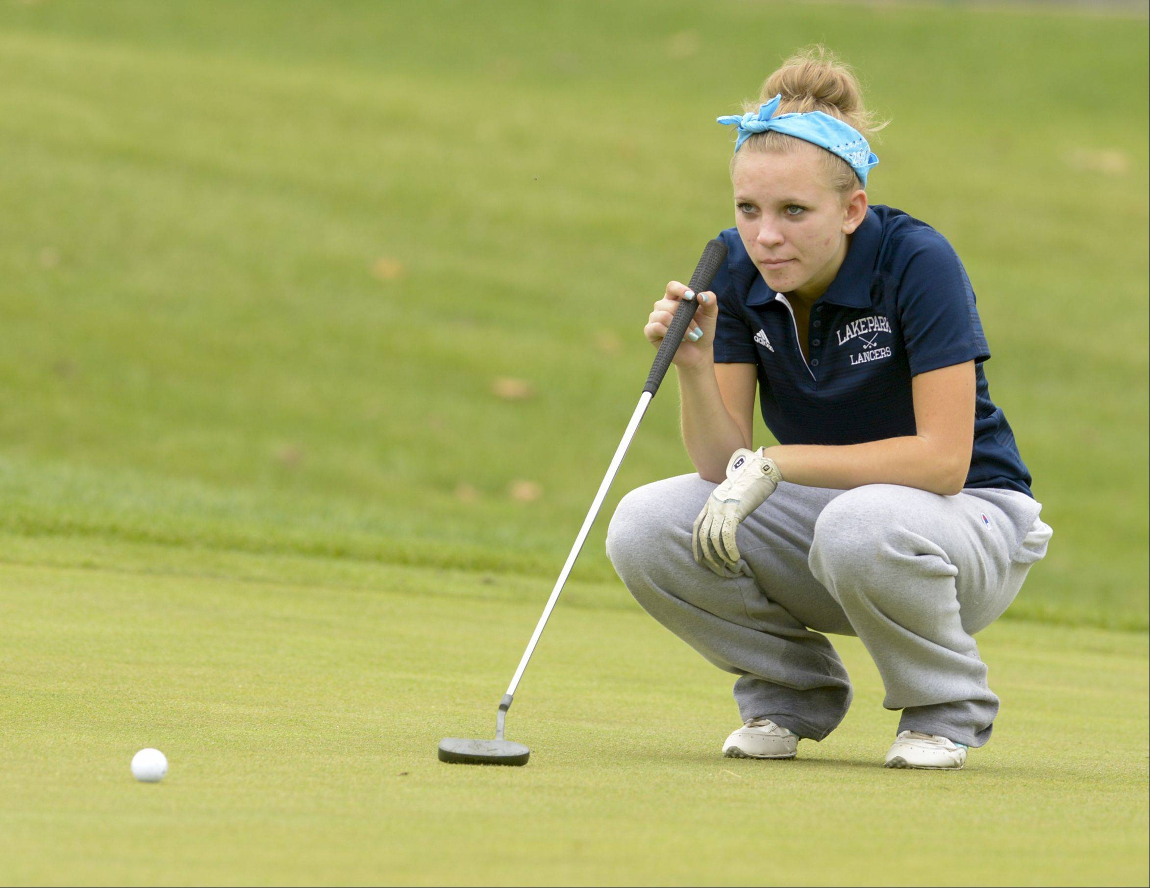 Madison McCallister of Lake Park checks the green before make her putt during the DuPage Valley Conference girls golf at Phillips Park Golf course in Aurora, Tuesday.