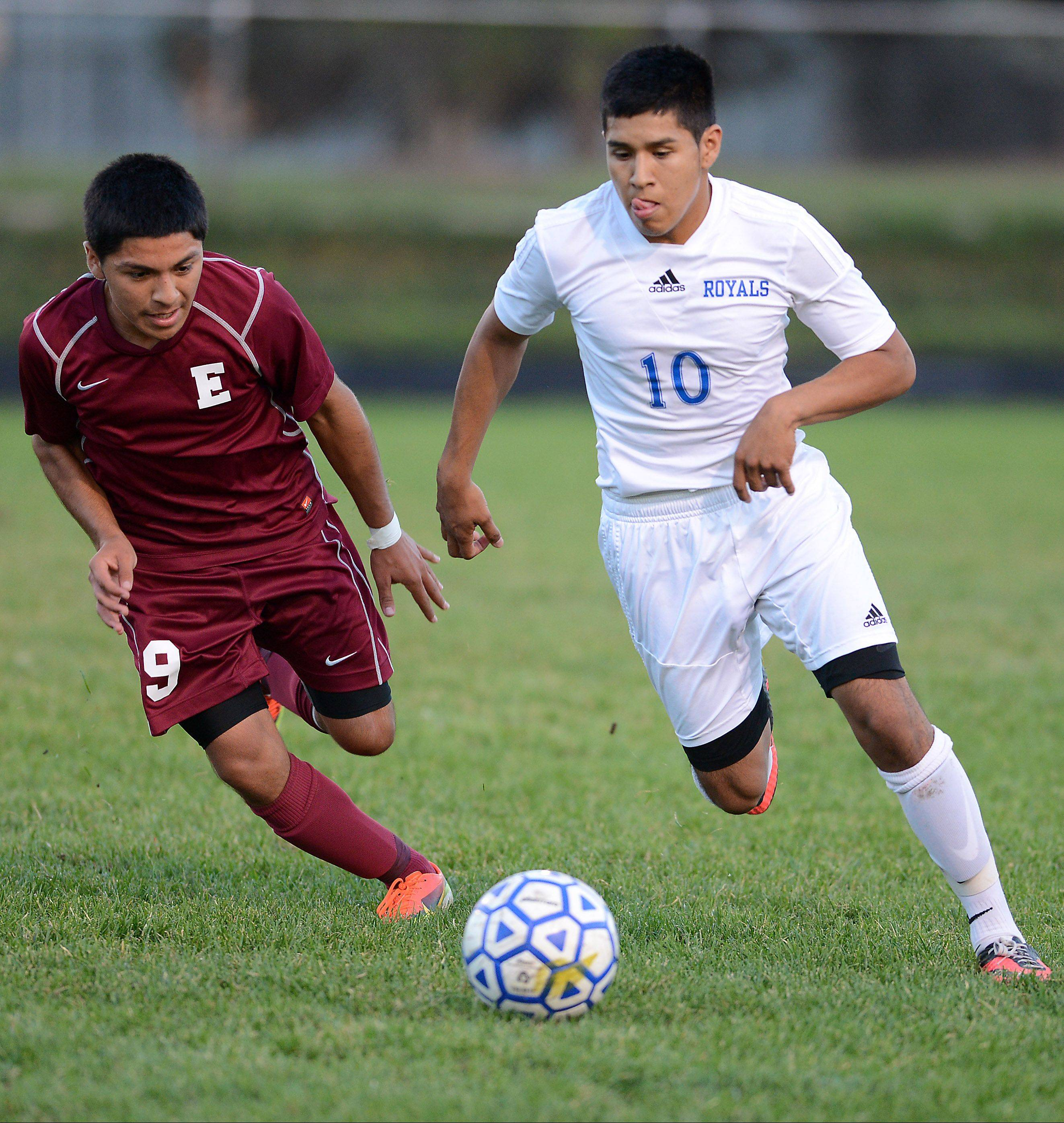 Larkin's Gonsalo Garcia brings the ball through the midfield with Elgin's Jose Jaimes giving chase during Tuesday's game at Memorial Field in Elgin.