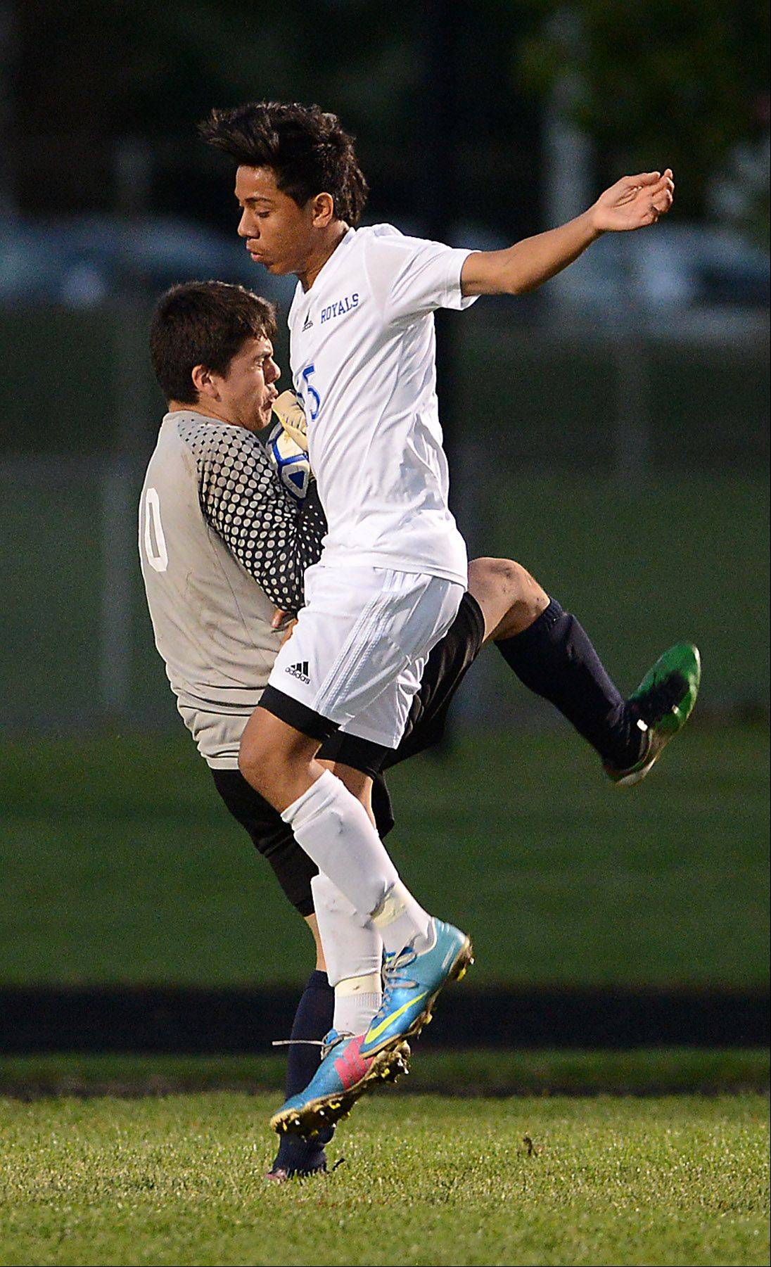 Larkin's Ricardo Nava collides with Elgin goalkeeper Flavio Jaimes during Tuesday's game at Memorial Field in Elgin.