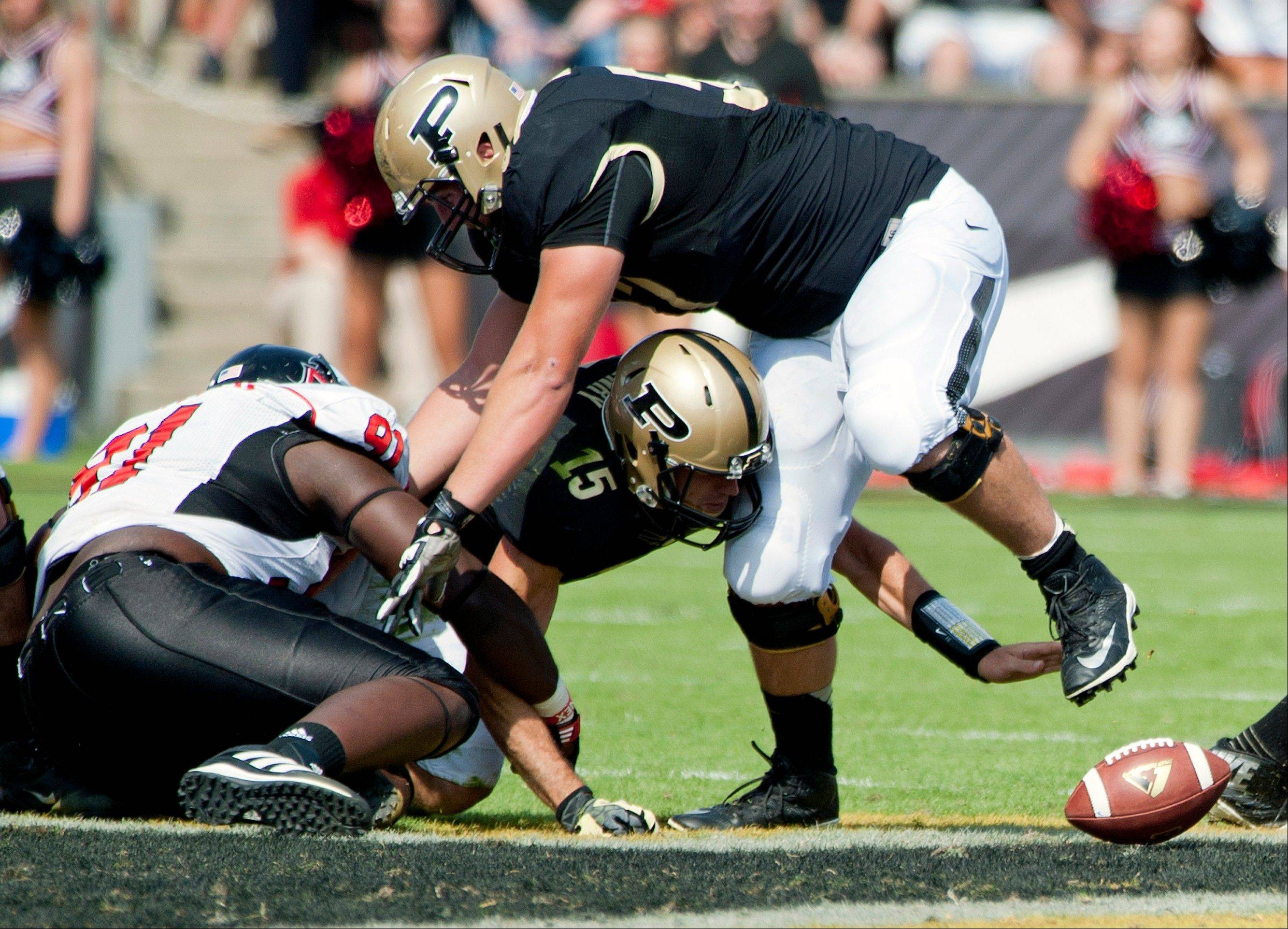 Purdue quarterback Rob Henry loses the football against Northern Illinois during Saturday's game at Ross-Ade Stadium in West Lafayette, Ind.
