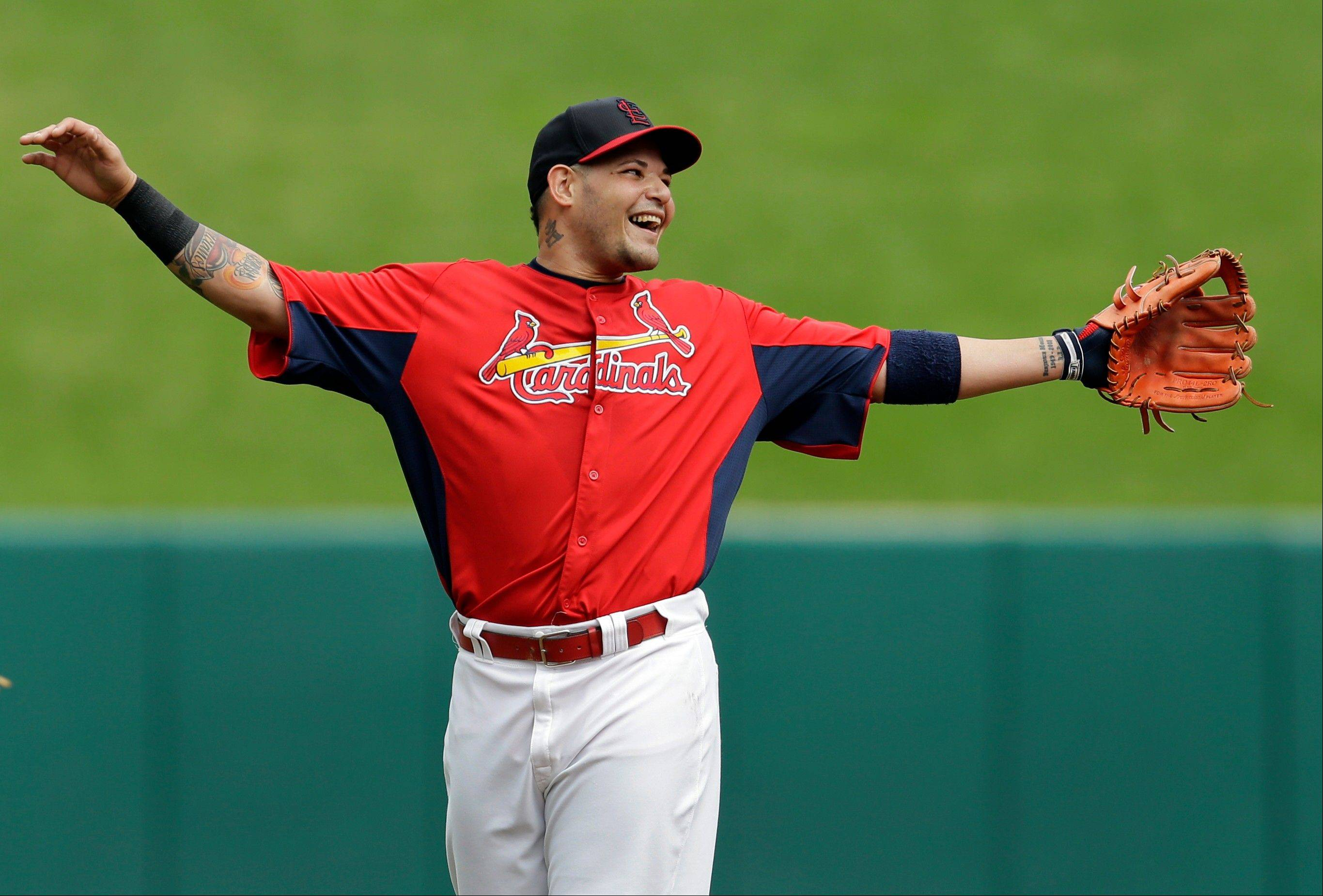St. Louis Cardinals catcher Yadier Molina laughs during baseball practice Tuesday in St. Louis. The Cardinals are set to host Game 1 of the NL division series on Thursday, gainst the winner of Tuesday's wild-card game between the Cincinnati Reds and Pittsburgh Pirates.