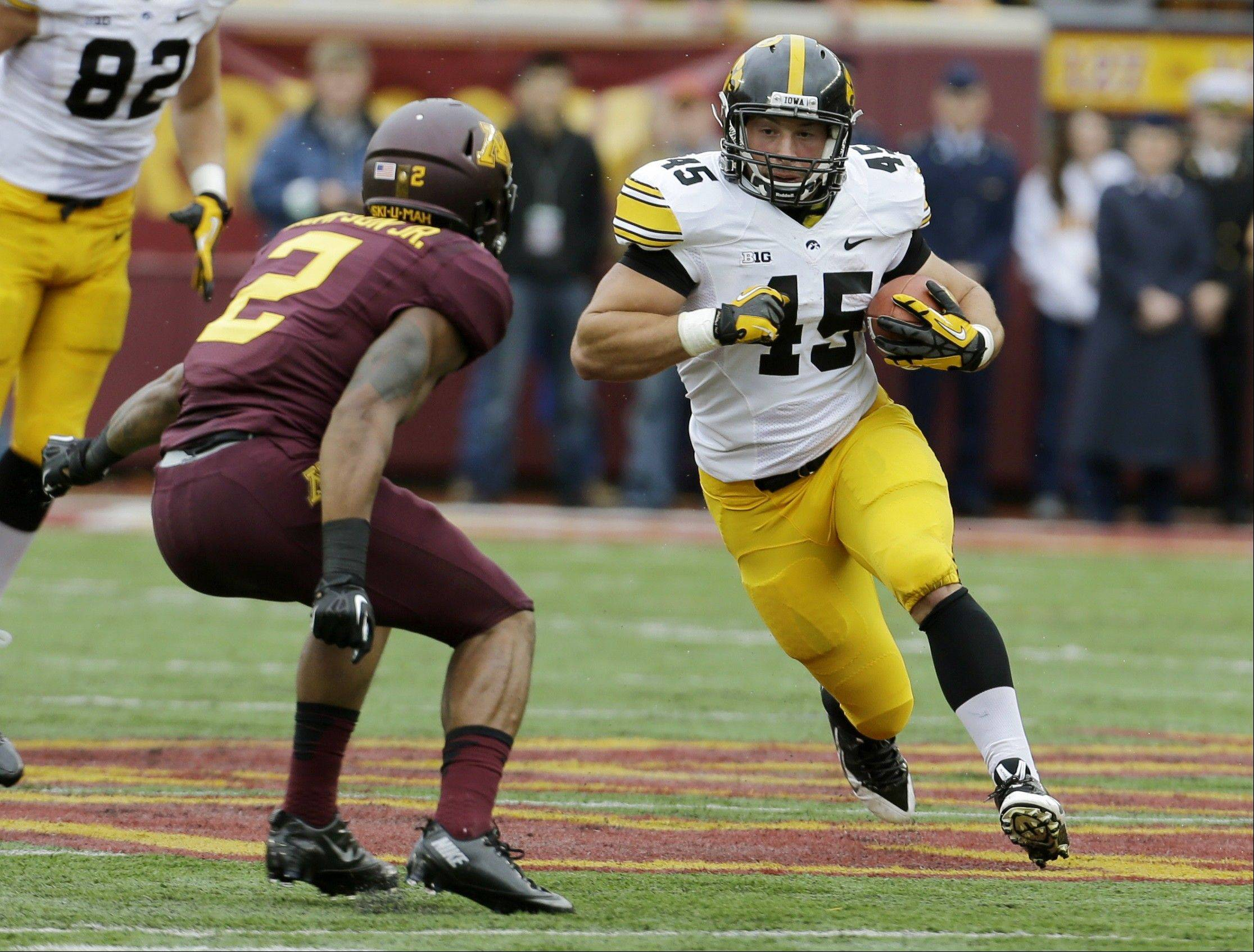 Iowa Hawkeyes fullback Mark Weisman, a Stevenson grad, carries the ball during the first quarter of Saturday's game against Minnesota in Minneapolis.