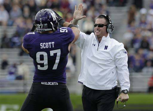 Northwestern head coach Pat Fitzgerald celebrates with Tyler Scott after Maine kicker Sean Decloux  missed a field goal during the first quarter of the Sept. 21 game in Evanston.