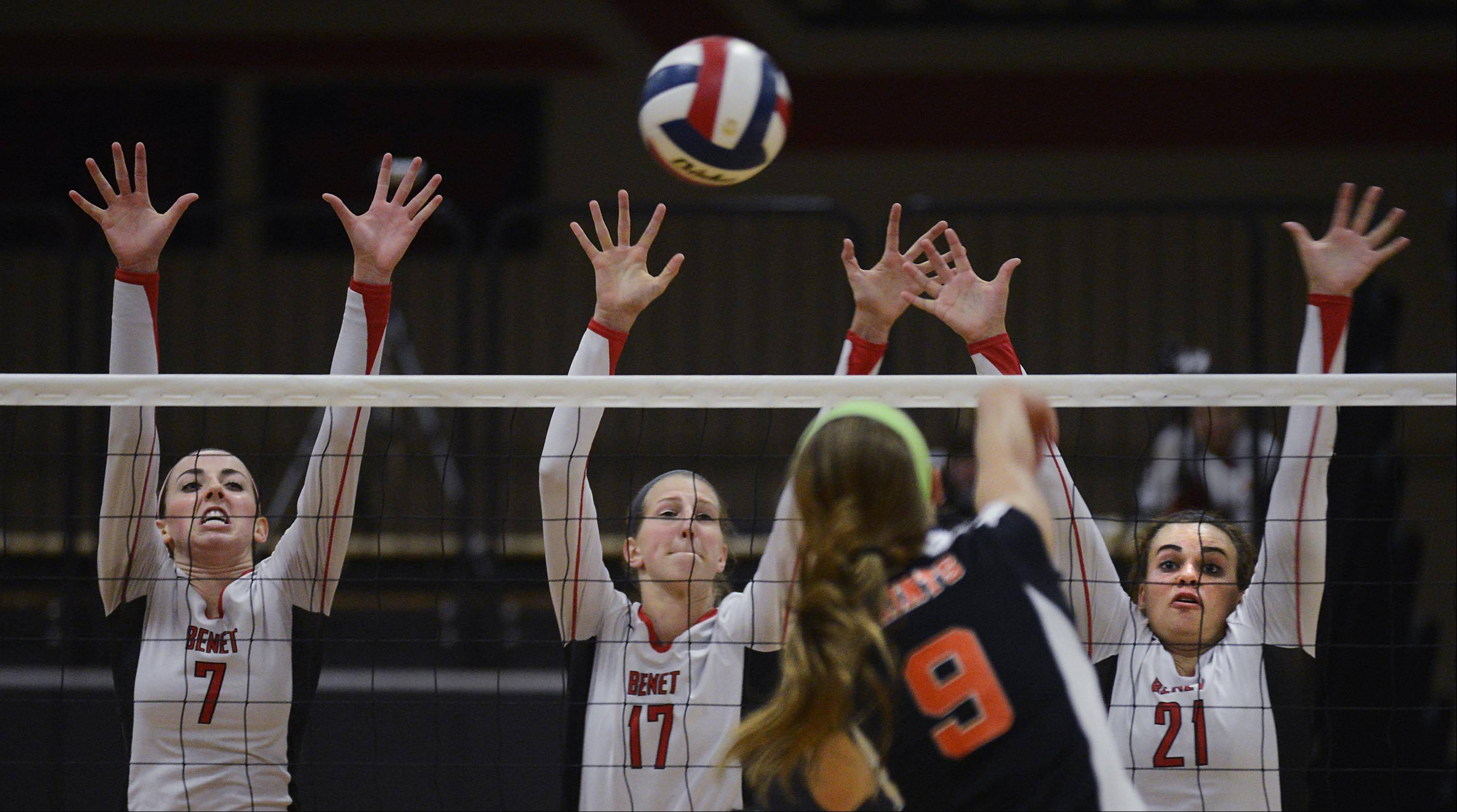 St. Charles East's Megan Schildmeyer sends a shot toward the triple defense of Benet Academy's Whitney Battoe, from left, Marija Cyvas and Ashley Hitchcock Wednesday in St. Charles.