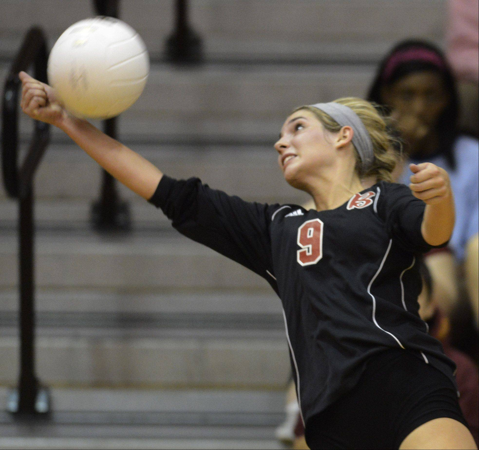 Barrington's Emily Watkins reaches to keep the ball in play against Schaumburg Tuesday.