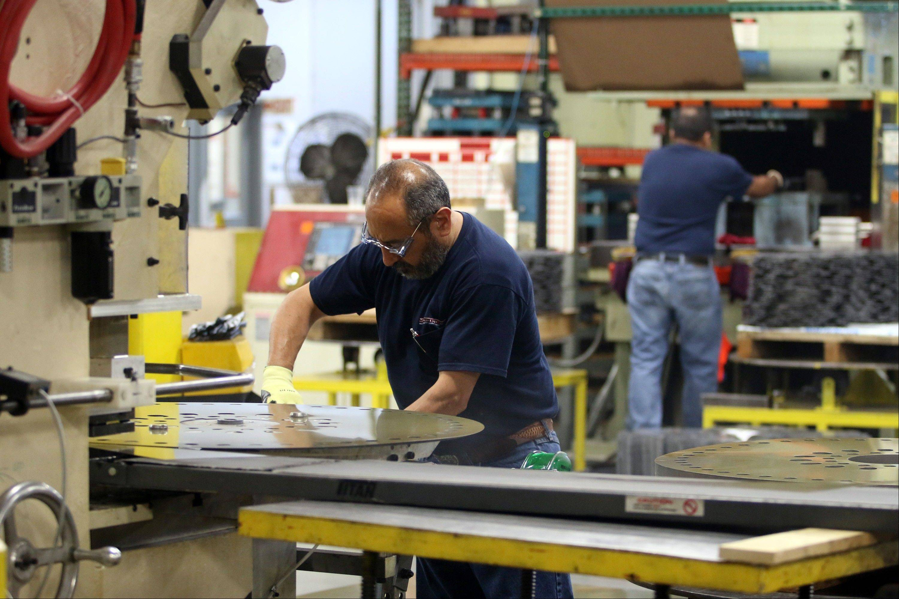 Punch press operators work at the Sko-Die Inc. custom metal manufacturing facility in Morton Grove. U.S. factory activity expanded last month at the fastest pace in 2 ½ years, an encouraging sign that manufacturing could lift economic growth and hiring in the coming months.