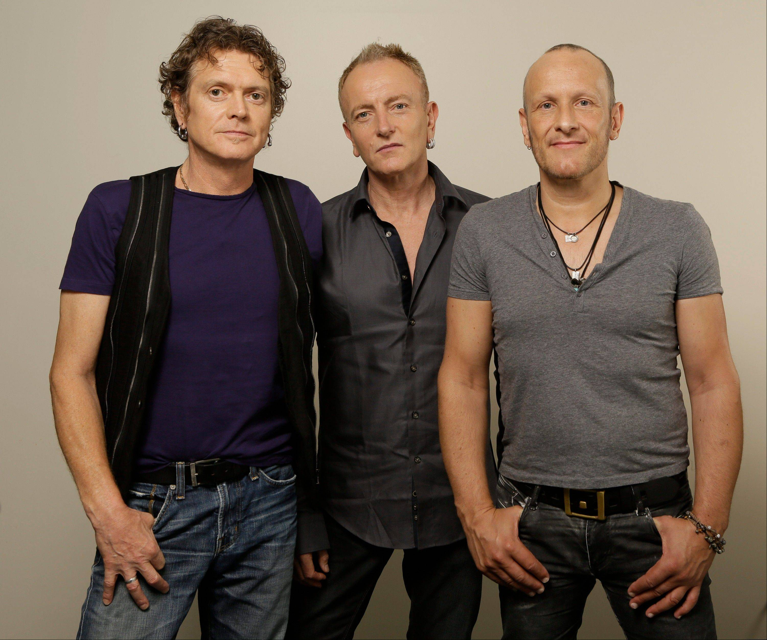 "British rock group Def Leppard, from left, Rick Allen, Phil Collen and Vivian Campbell, is screening its live concert film,""Def Leppard Viva! Hysteria Concert,"" at theaters nationwide."