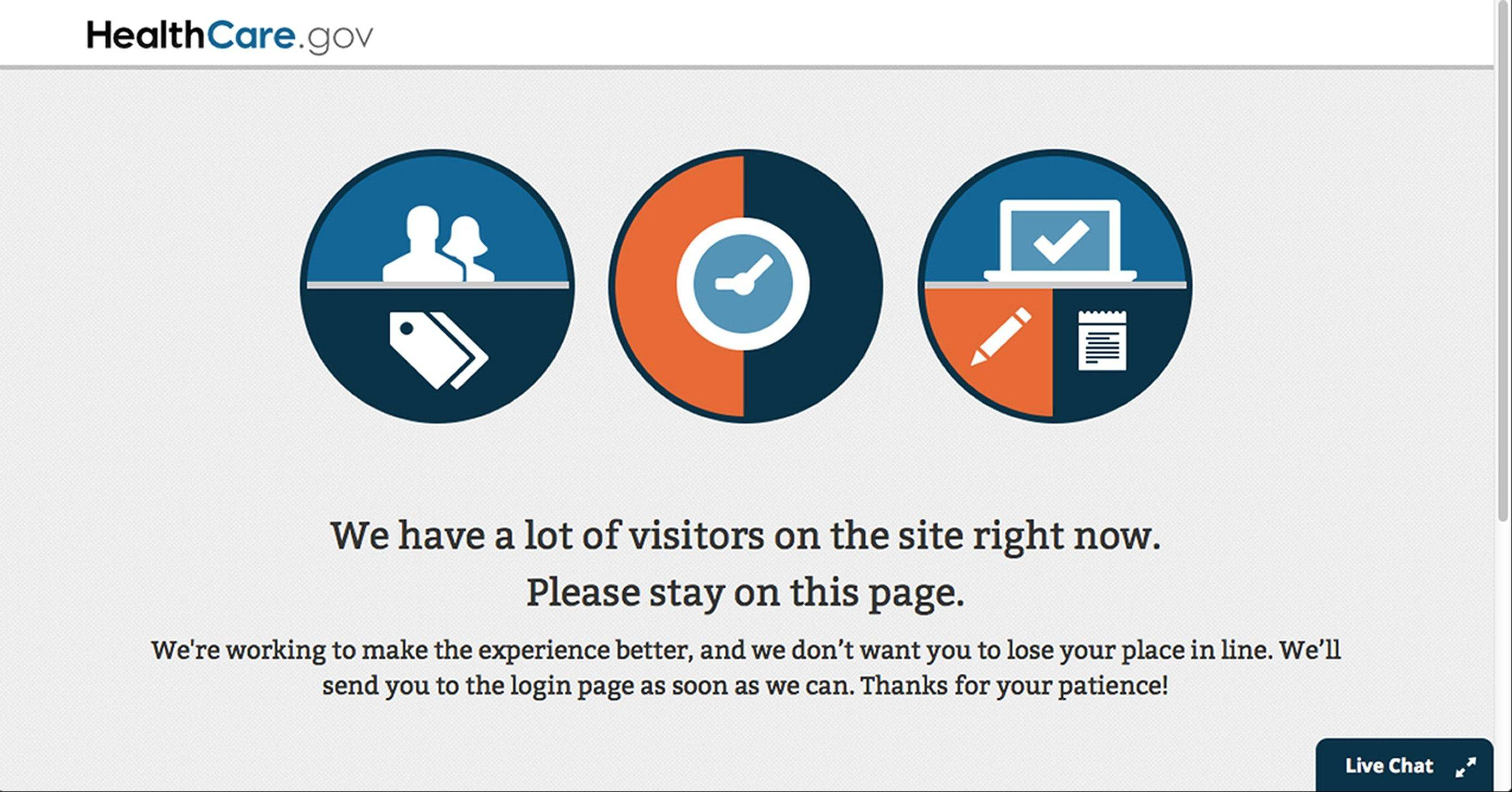 A page asks visitors to stay on during the login process of the Health Care Marketplace website Wednesday.