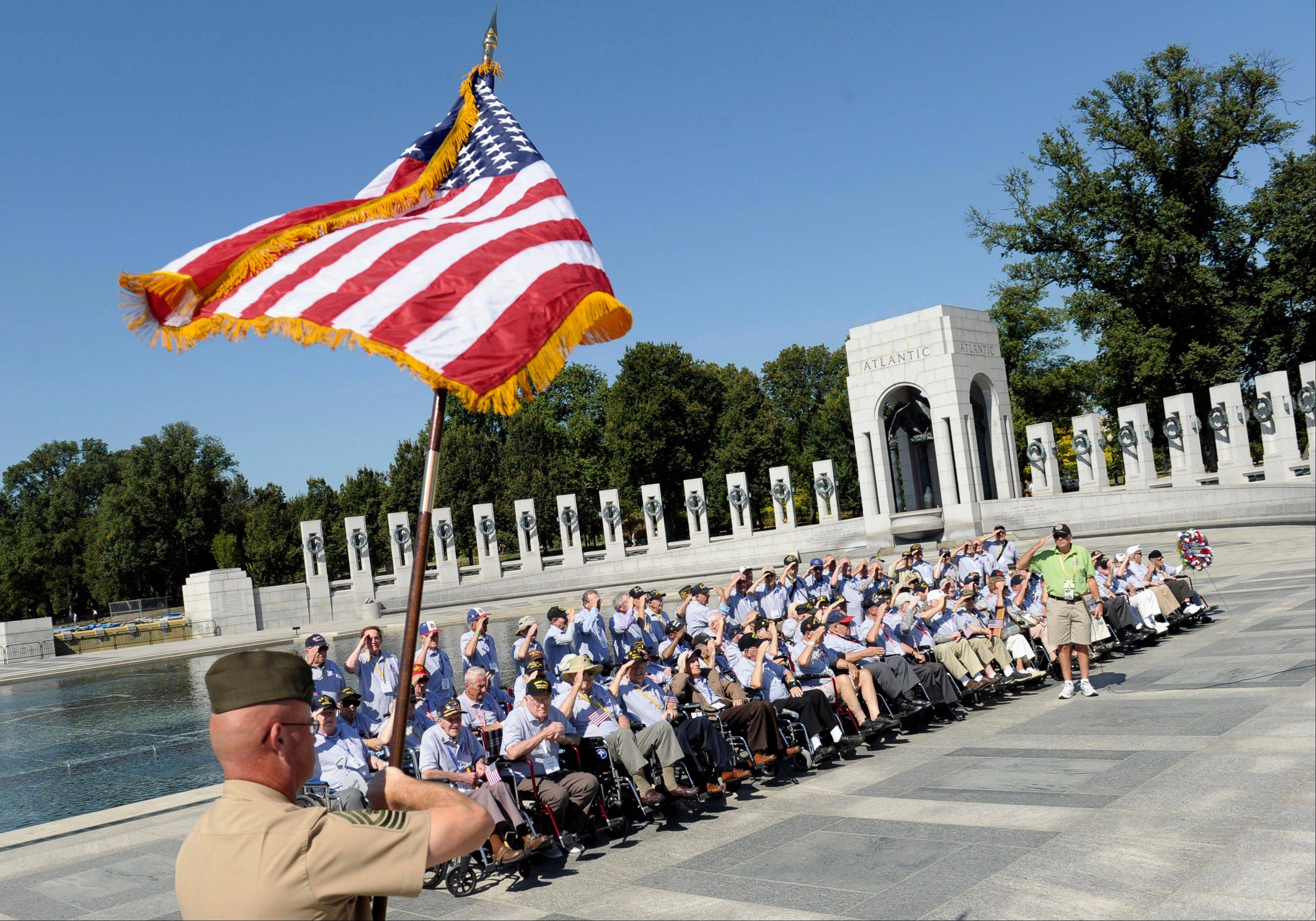 World War II veterans from the Chicago area salute Wednesday as the colors are presented at the World War II Memorial in Washington, D.C.