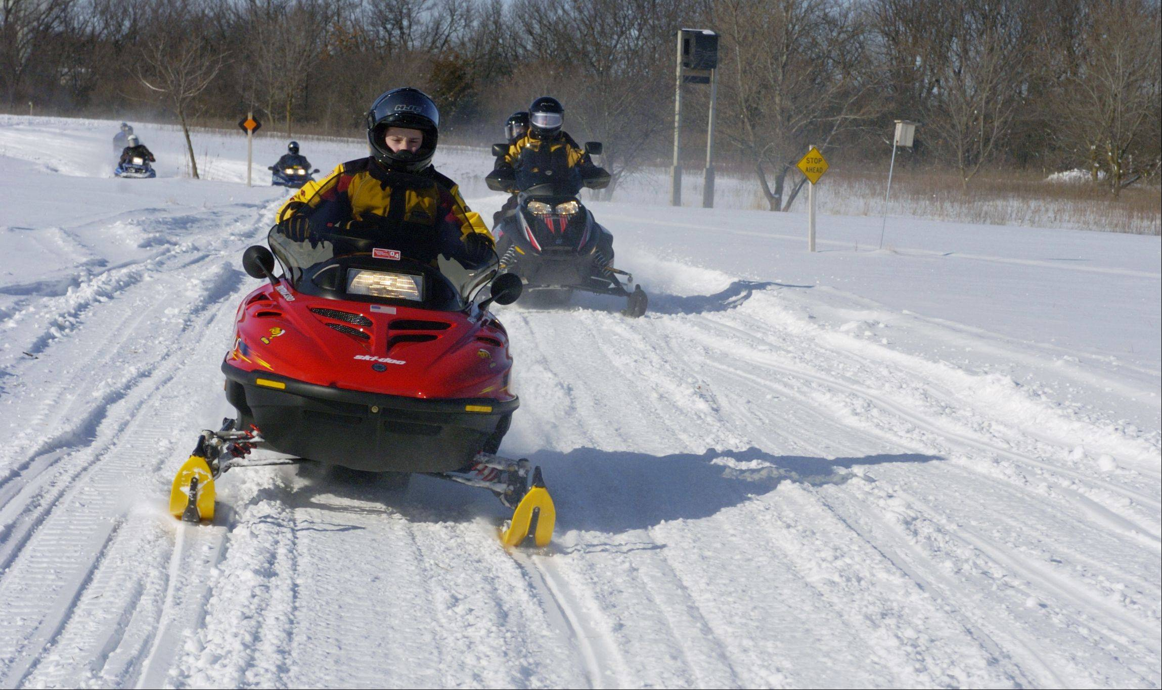 Riders participate in a Northeastern Illinois Association of Snowmobile Clubs safety event at the Lakewood Forest Preserve near Wauconda.