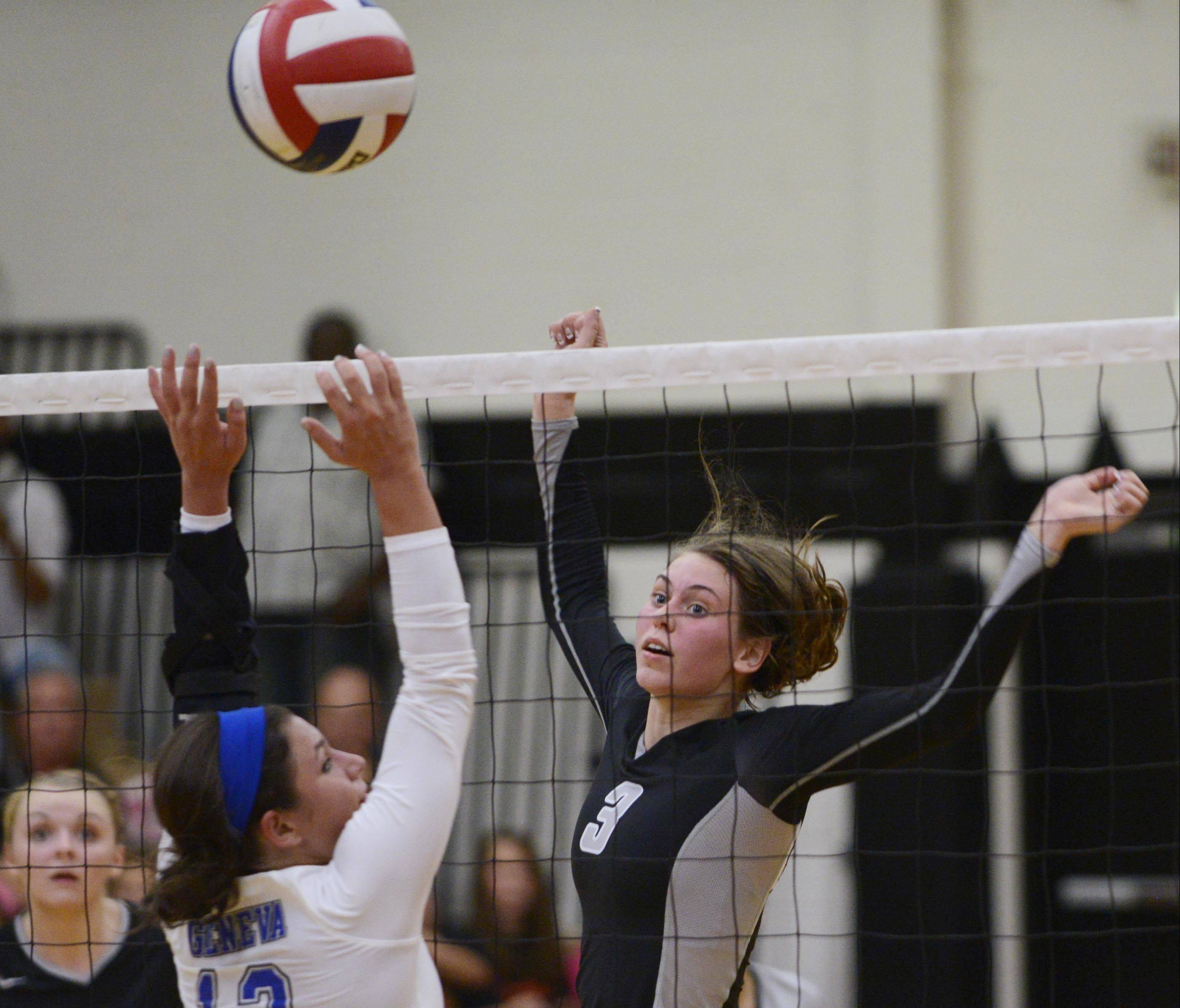 Geneva's Courtney Caruso tries to block Kaneland's Ellie Dunn.