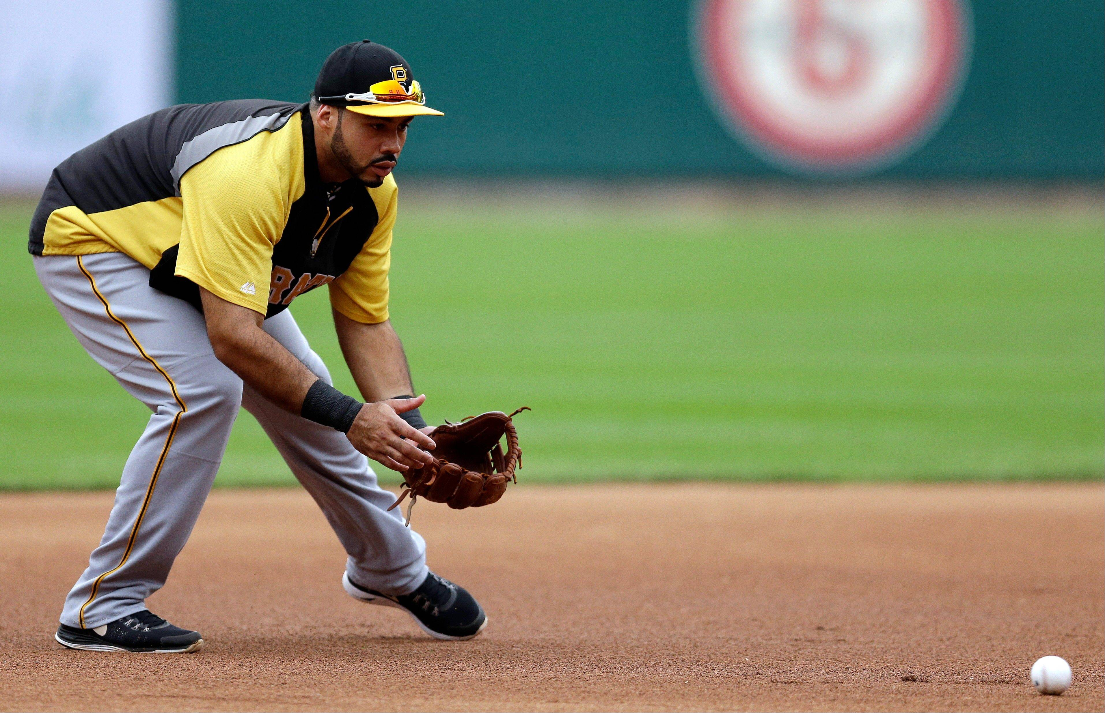 Pittsburgh Pirates third baseman Pedro Alvarez fields a ball during a workout Wednesday in Busch Stadium in St. Louis. Game 1 of the National League Division Series baseball playoff between the between the Pirates and the Cardinals is scheduled for Thursday.