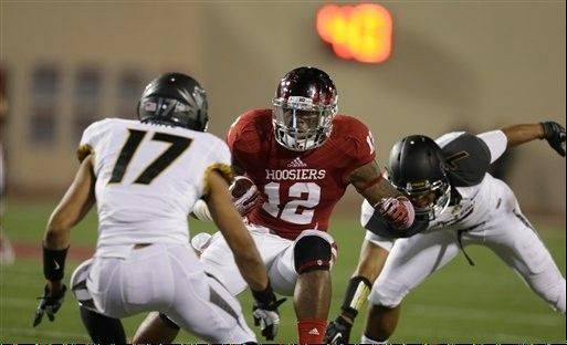Indiana�s Stephen Houston runs during the Sept. 21 game against Missouri in Bloomington, Ind. The Hoosiers average 7.2 yards per play.