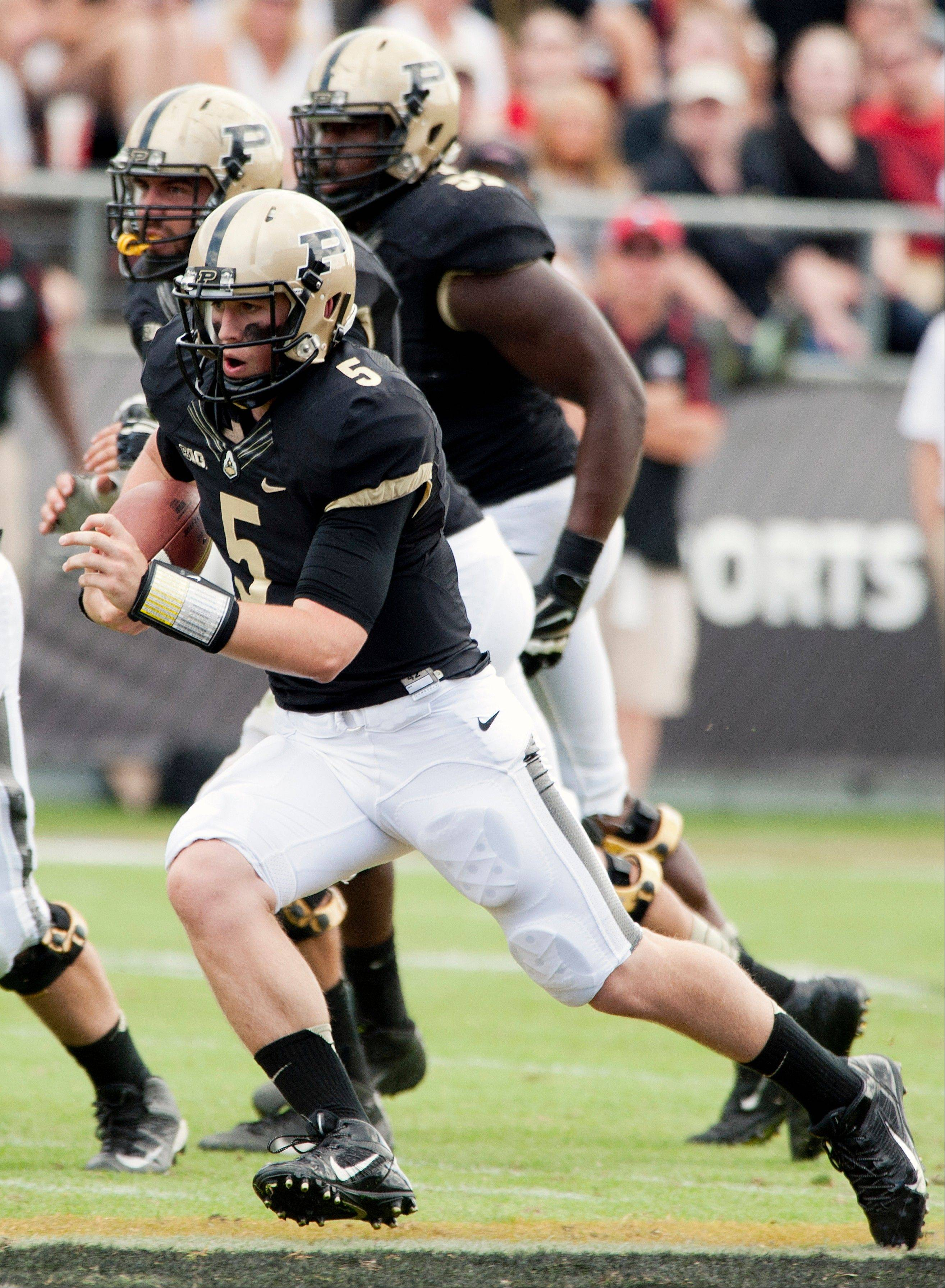 Purdue quarterback Danny Etling scrambles with the ball against Northern Illinois during last Saturday�s game in West Lafayette, Ind.