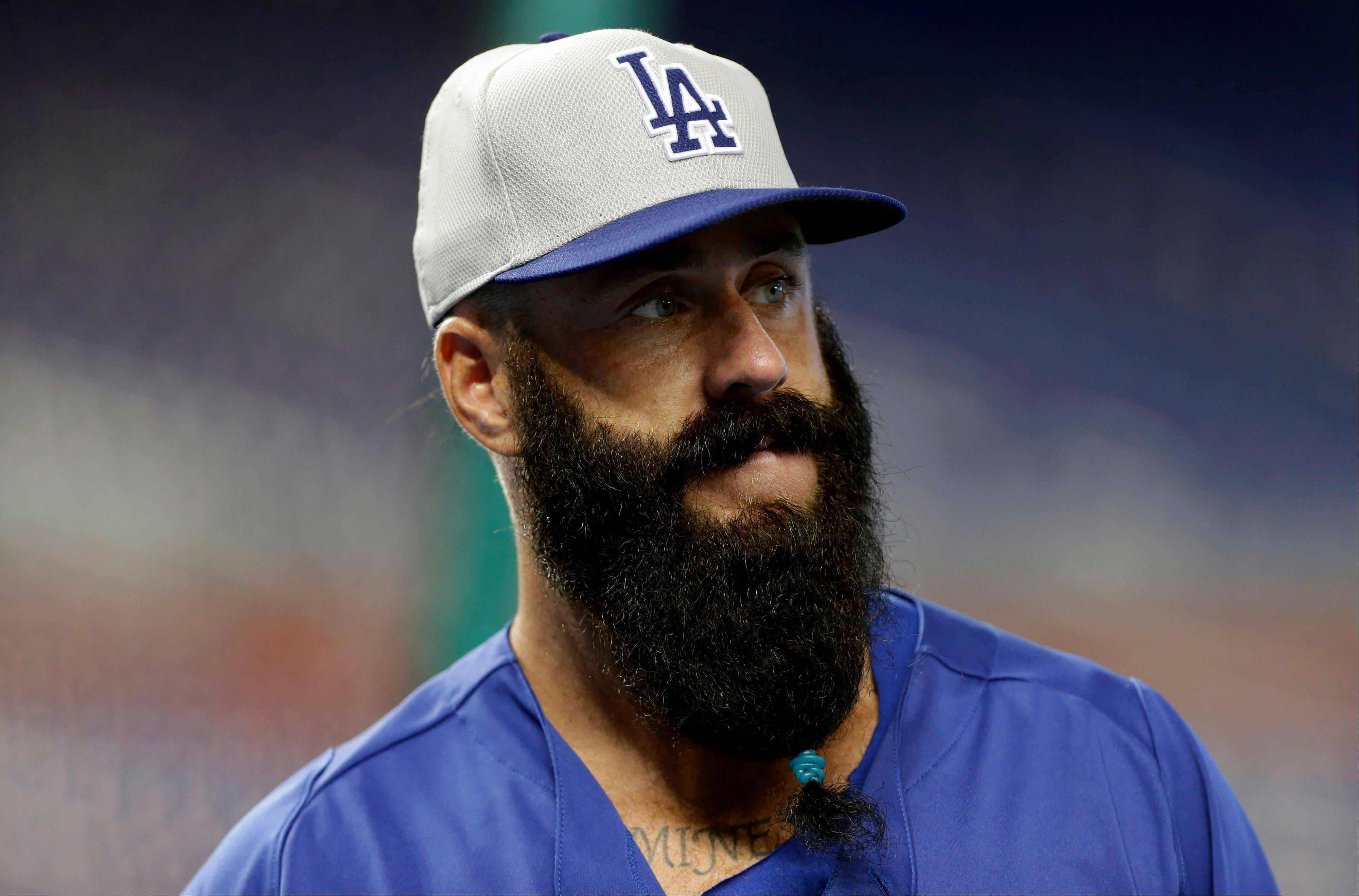 Los Angeles Dodgers relief pitcher Brian Wilson watching batting practice before an August game against the Miami Marlins.