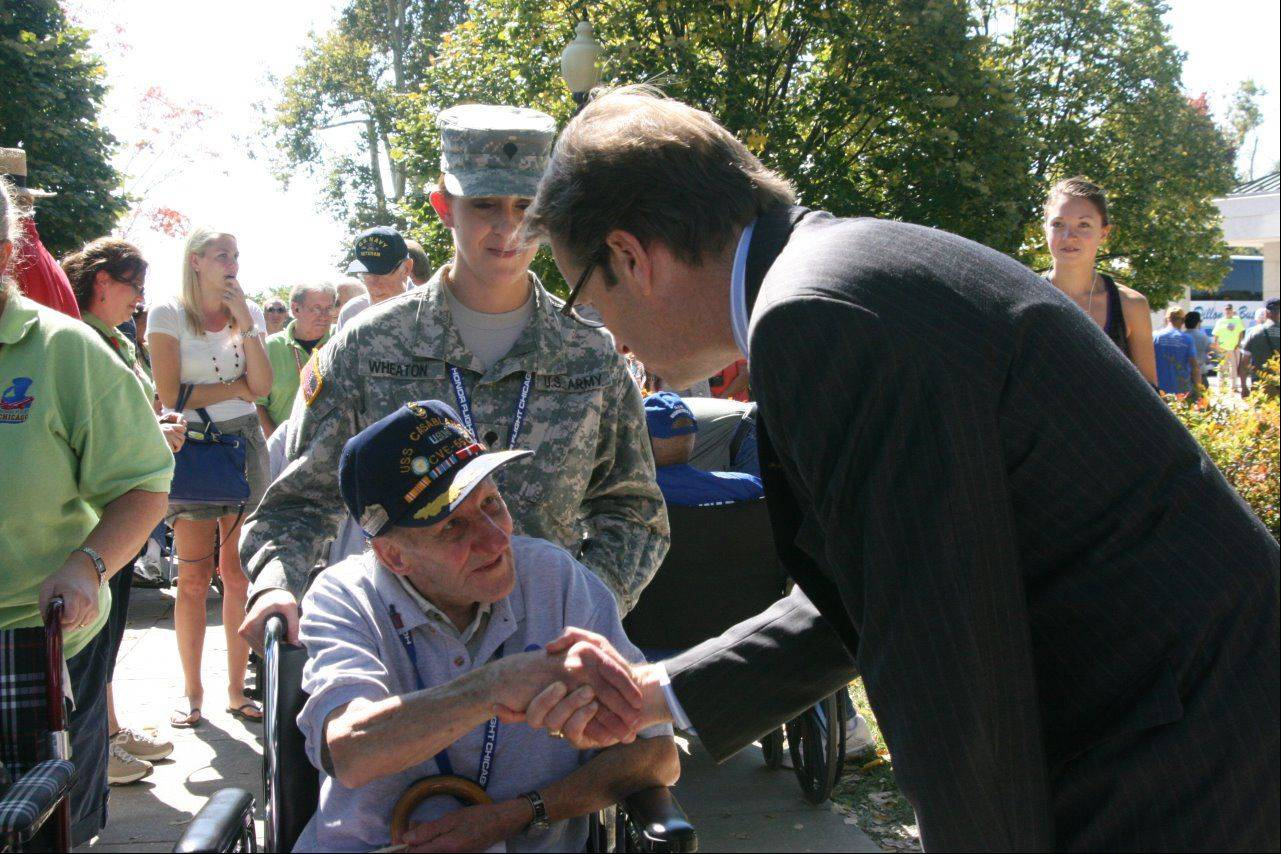 U.S. Rep. Peter Roskam of Wheaton shakes hands with World War II Navy veteran Hank Sidof Wednesday in Washington, D.C.