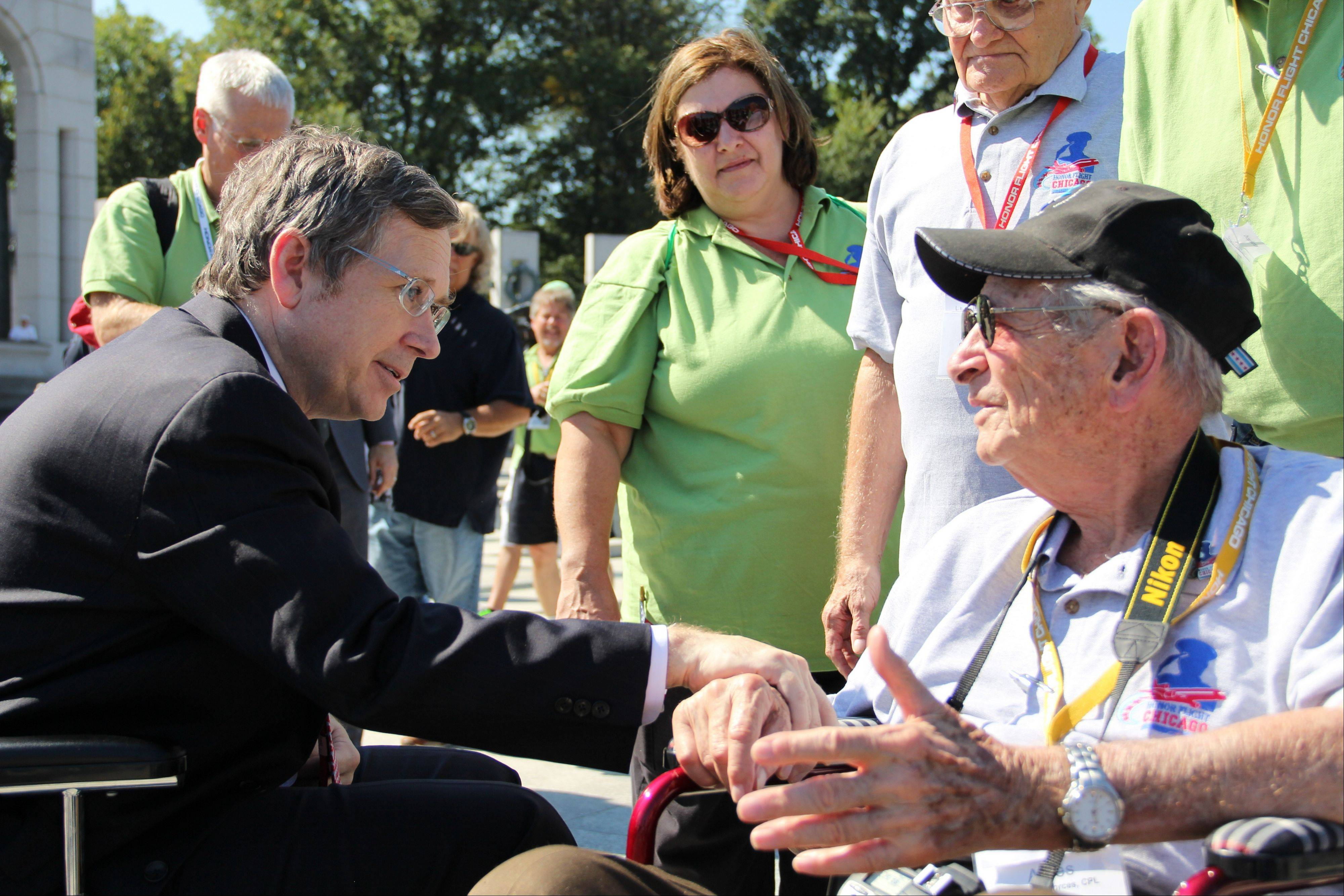 U.S. Sen. Mark Kirk of Highland Park greets World War II veterans Wednesday at the war's national memorial in Washington, D.C.