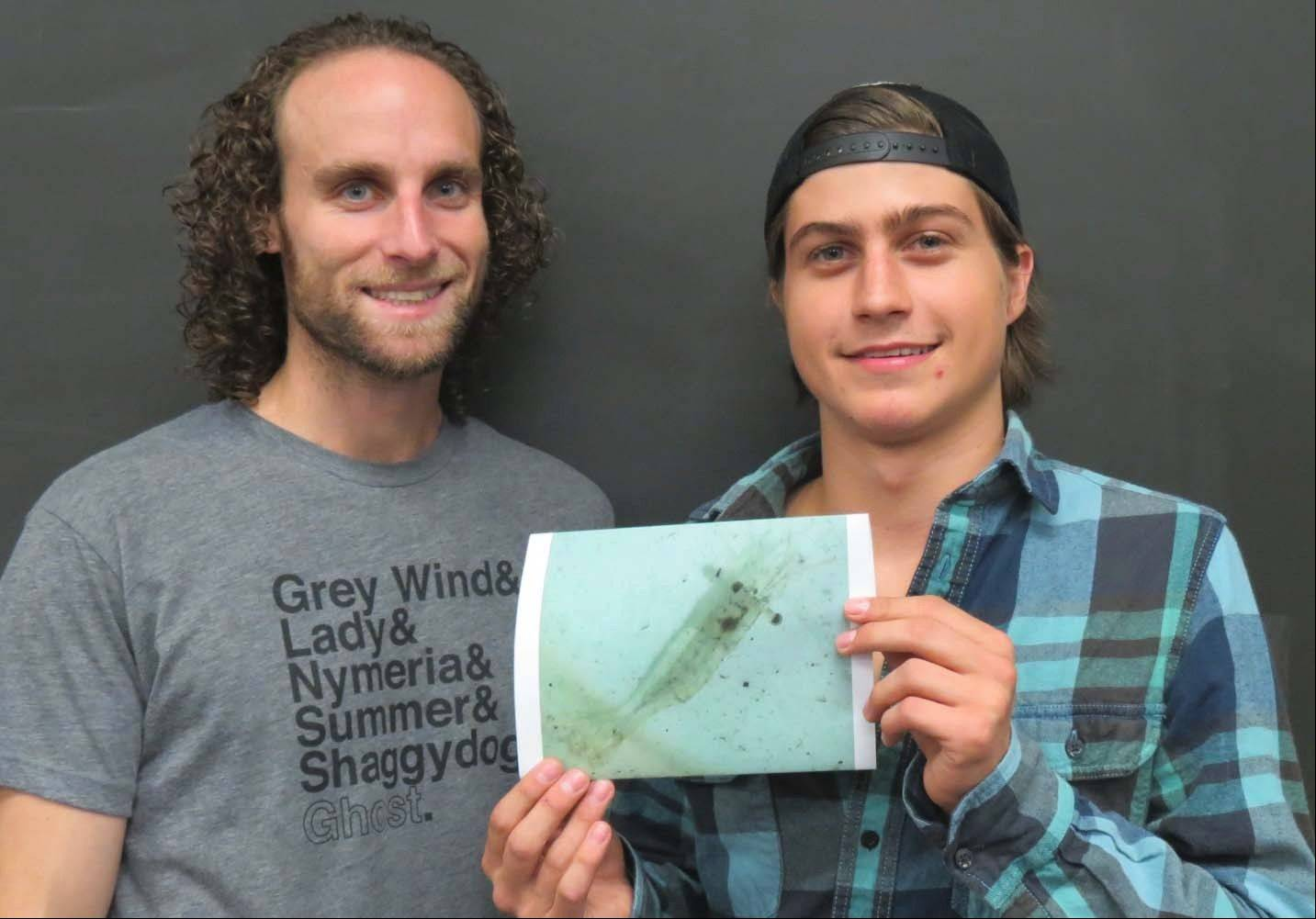 Oakton student Michael Buffo-Genyk (right), and Paul Gulezian, assistant professor of biology, display a picture of a rare find -- a Mississippi grass shrimp. Buffo-Genyk recently found the shrimp in the Des Plaines River as part of his Introduction to Environmental Science class.