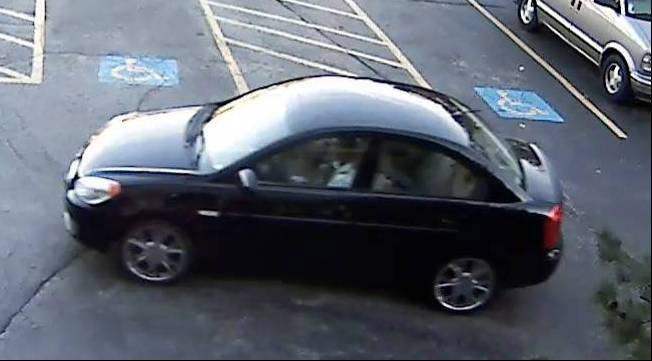 The subject involved in a Mundelein abduction of a child was seen driving a navy blue or black compact car with aftermarket wheels, possibly 2006-2008 Hyundai Accent 4-door sedan.