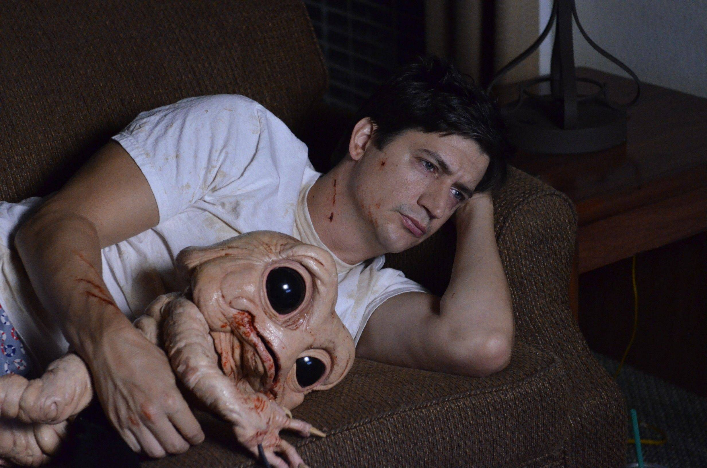 "Duncan (Ken Marino) bonds with a protective polyp from his intestines in the silly, absurd horror comedy ""Bad Milo."""