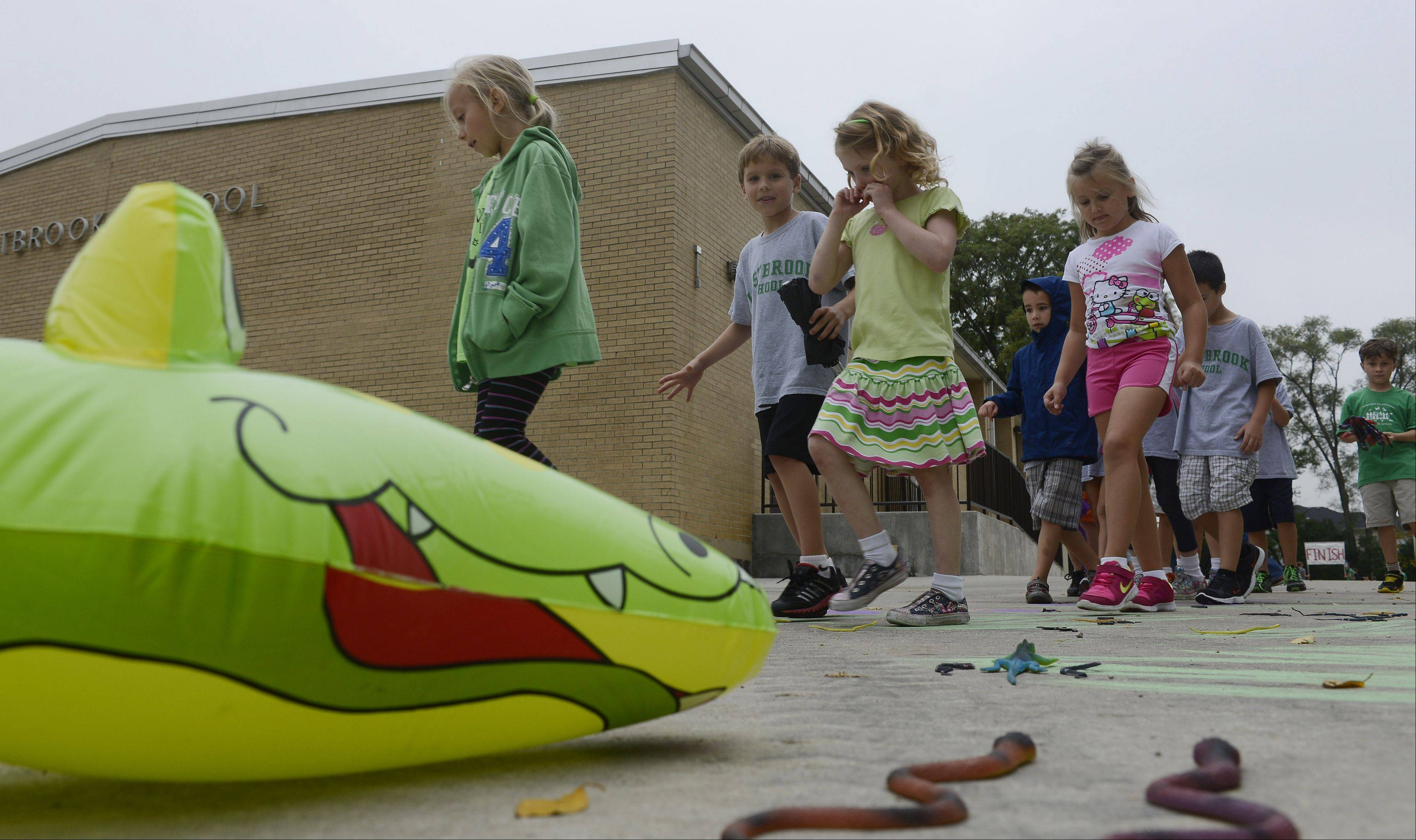 Students tiptoe through �Alligator Alley,� one of the many events that kept the Walk for Westbrook interesting on Friday.