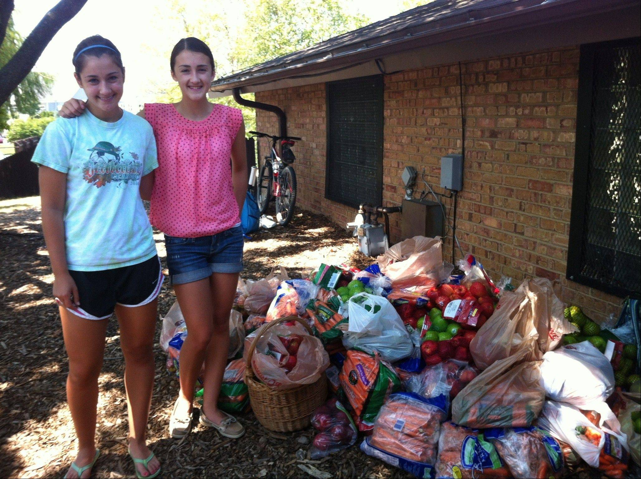 Hannah and Emma Koropp of Wheaton created the Apples and Carrots Fragile Food Drive in 2010 and continue to collect perishable items for families in need.