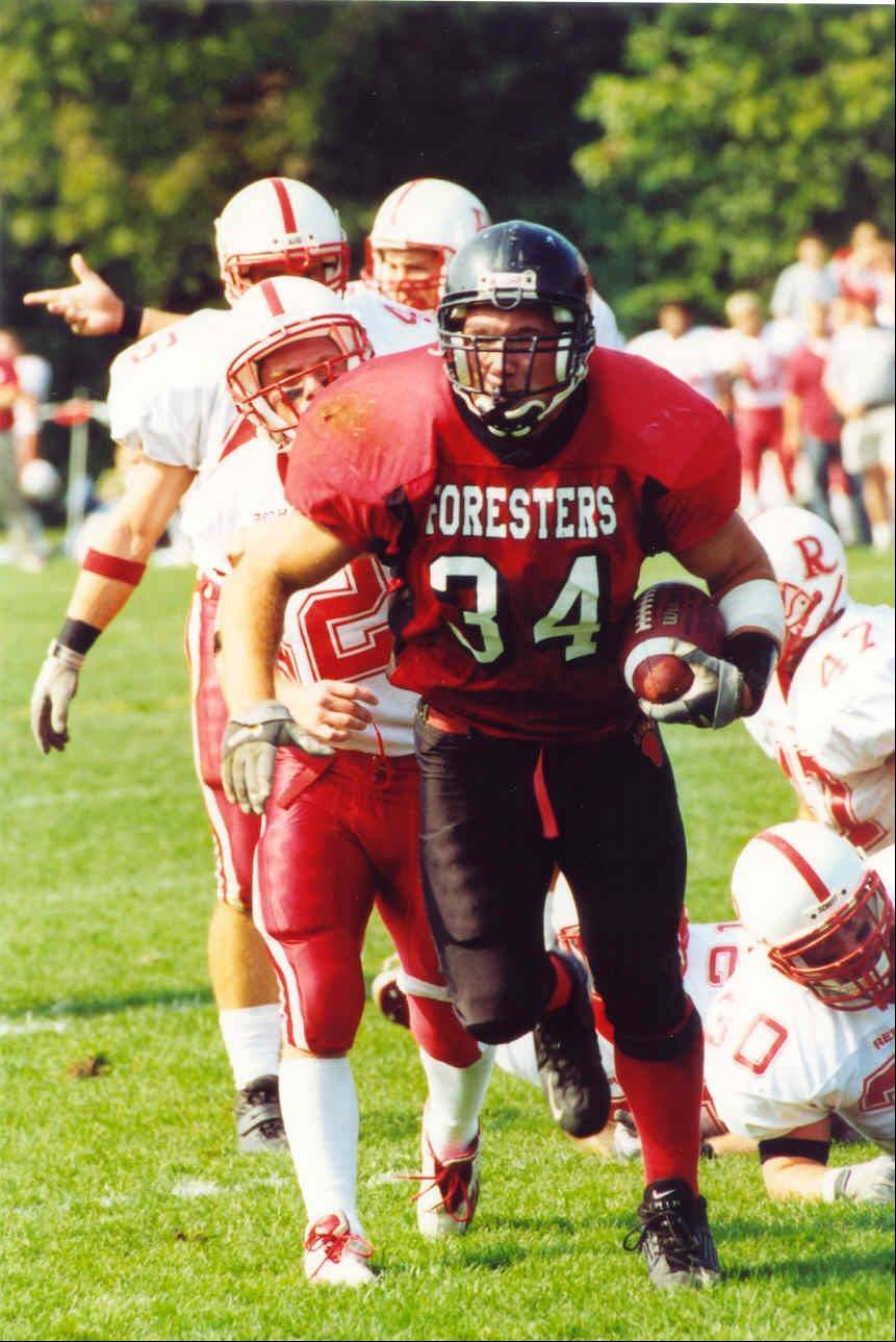 Mettawa Mayor Casey Urlacher runs the football in his Lake Forest College playing days that had him on offense and defense. The 2003 graduate will be inducted into the college�s athletic hall of fame Saturday.
