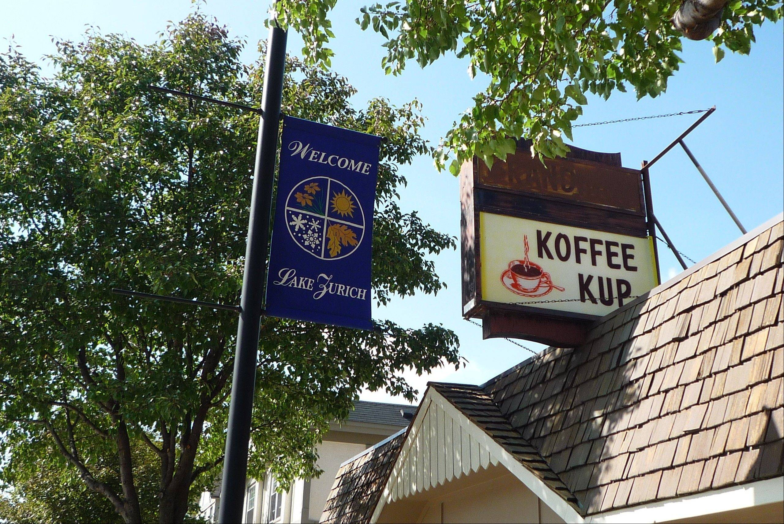 """Gravity"" star Sandra Bullock has never eaten here, and the menu does not have a ""Dr. Ryan Stone"" sandwich named after her character. Customers at the Koffee Kup diner in downtown Lake Zurich aren't sure how their suburb earned a mention from Bullock's character in the movie opening tonight."