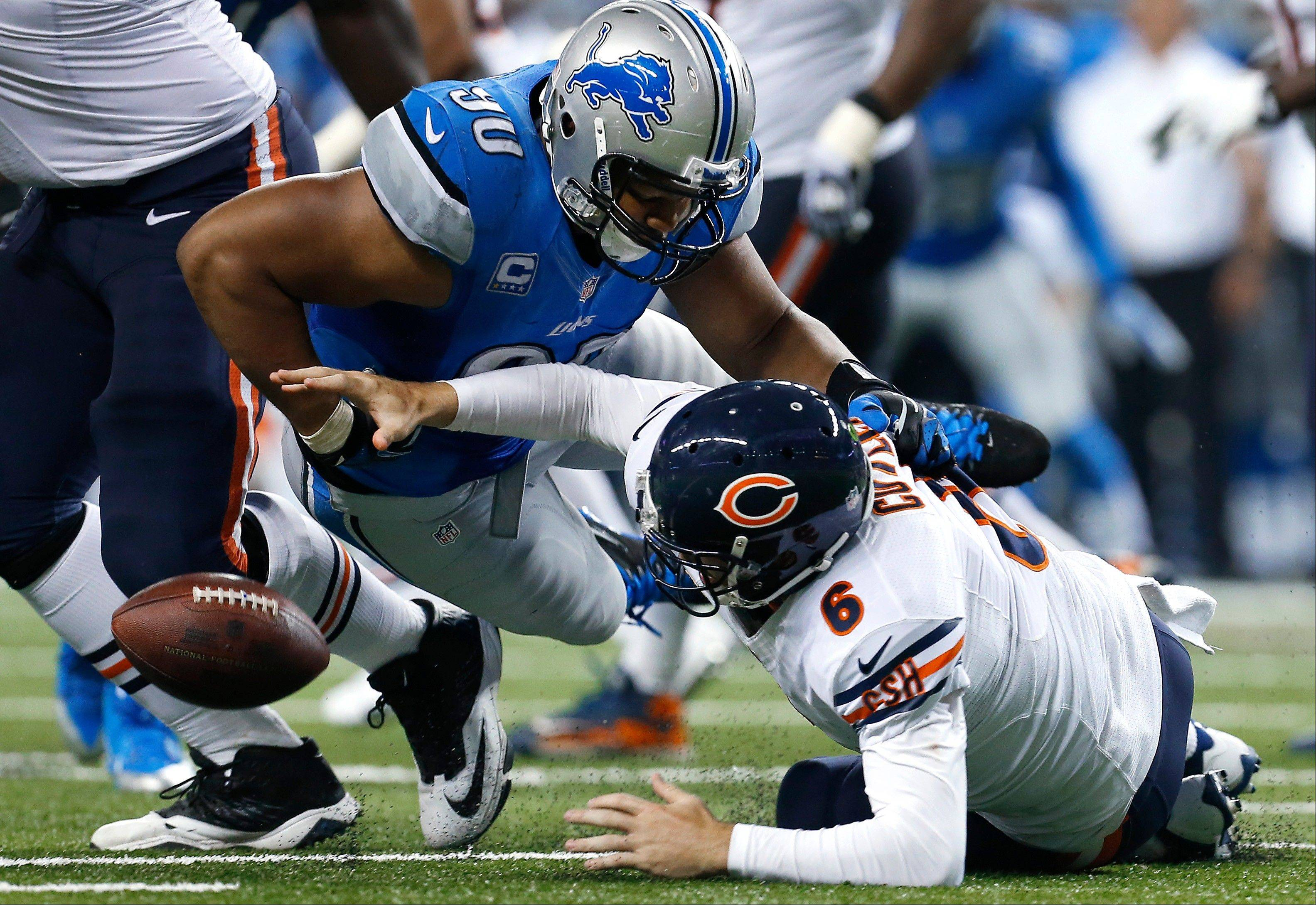 The Lions' Ndamukong Suh forces a fumble by Jay Cutler that defensive tackle Nick Fairley recovered for a touchdown during the third quarter of the Bears' loss Sunday. It was 1 of 4 turnovers by Cutler on the afternoon.