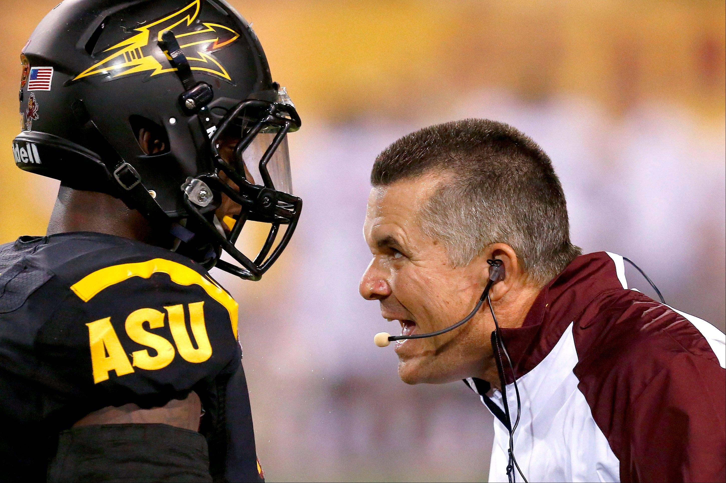 Arizona State head coach Todd Graham tries to make a point to Anthony Jones during the Sept. 14 win over Wisconsin. Beating Notre Dame on Saturday at the end of a four-game gauntlet would be a nice capper for the No. 22 Sun Devils, giving them a huge boost on the national stage.