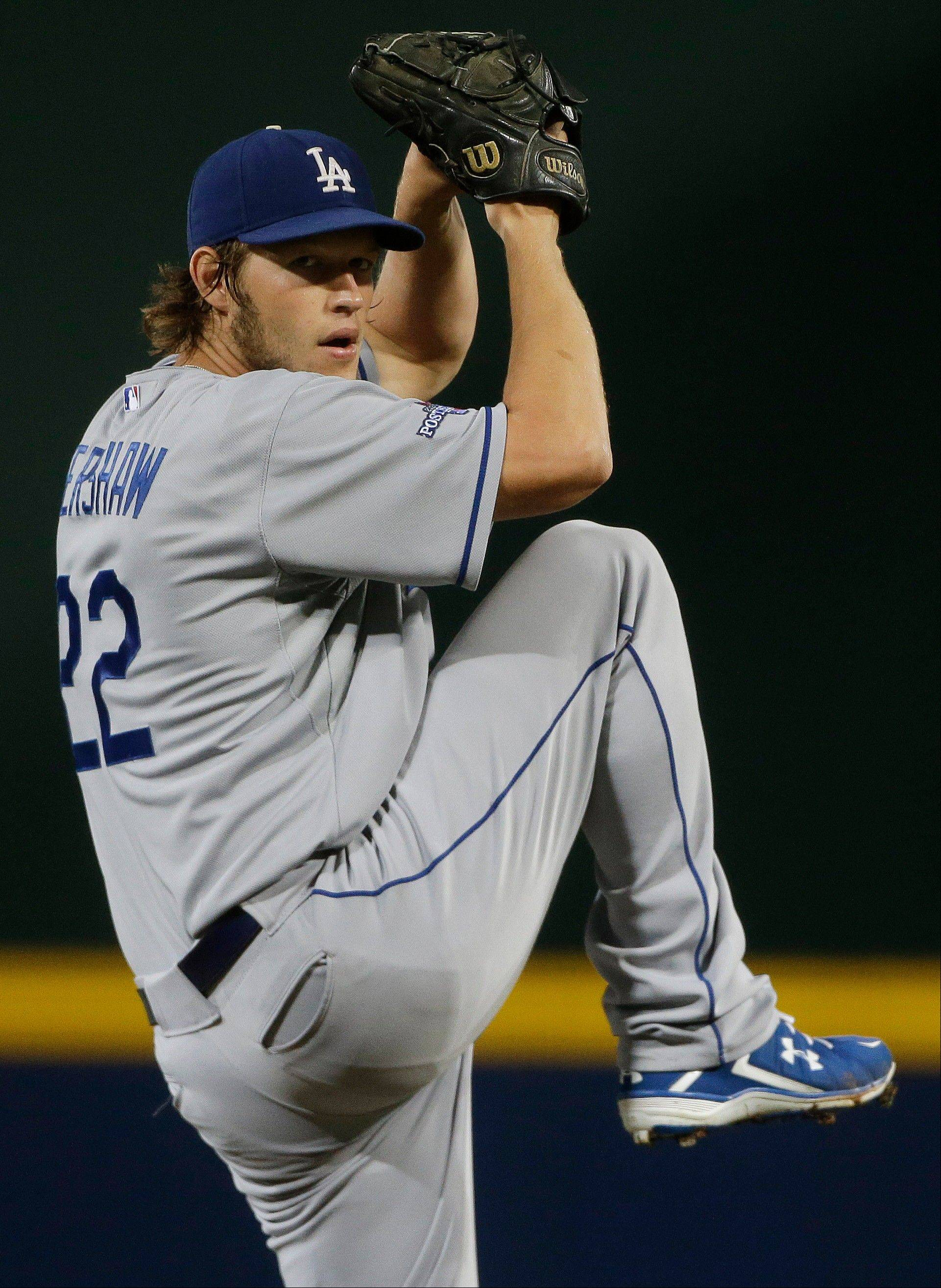 Los Angeles Dodgers starting pitcher Clayton Kershaw works against Atlanta Braves in the first inning of Game 1 of the National League Divisional Series, Thursday, Oct. 3, 2013, in Atlanta. (AP Photo/David Goldman)