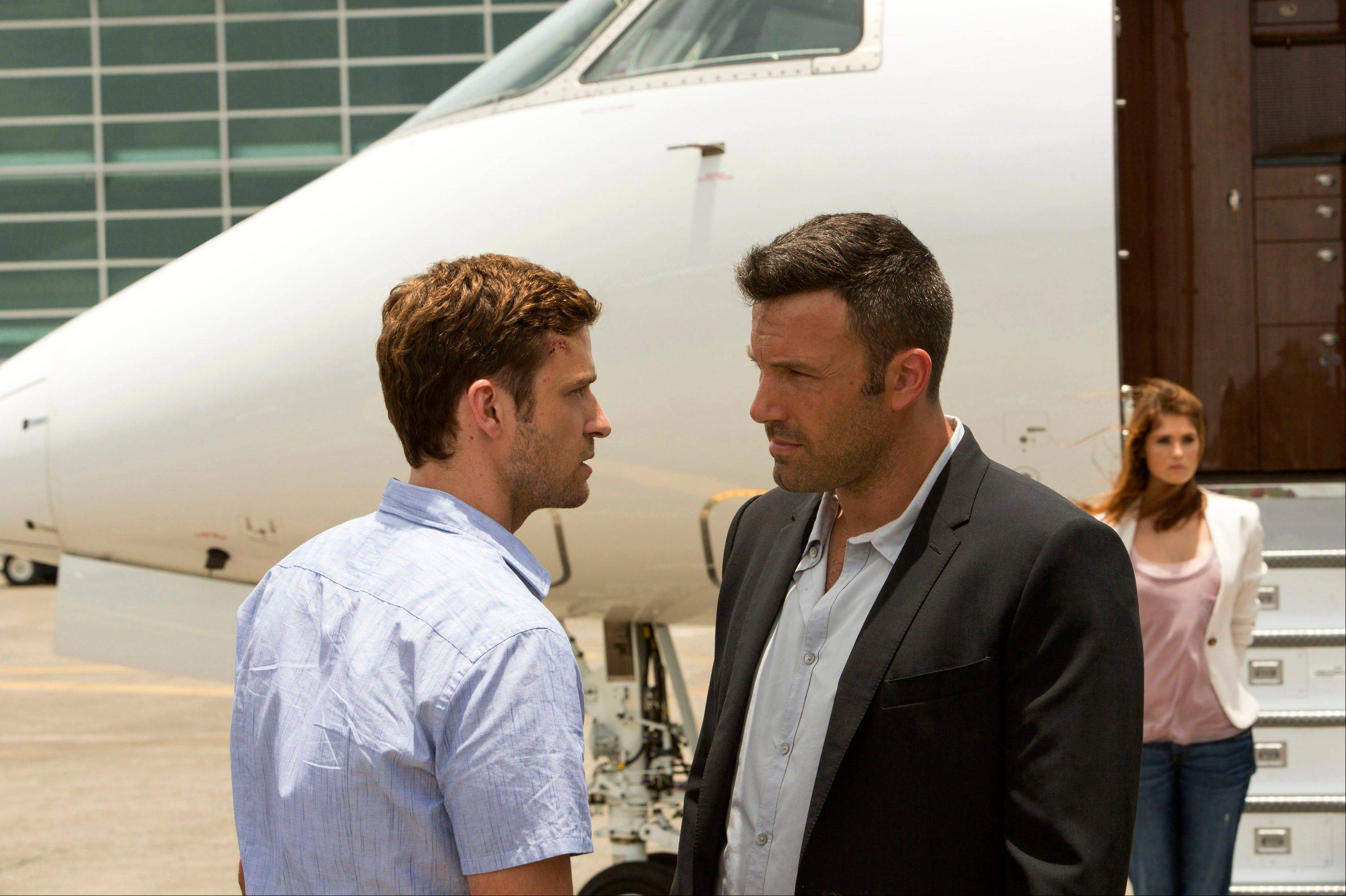 "Young gambler Richie (Justin Timberlake, left) goes to work for a dangerous offshore operator (Ben Affleck) in ""Runner Runner."""