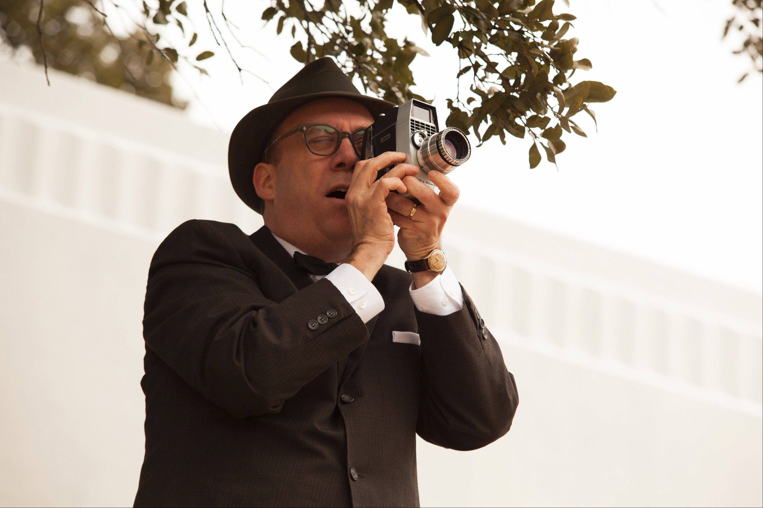 "Abraham Zapruder (Paul Giamatti) unwittingly captures the assassination of President John F. Kennedy in ""Parkland."""